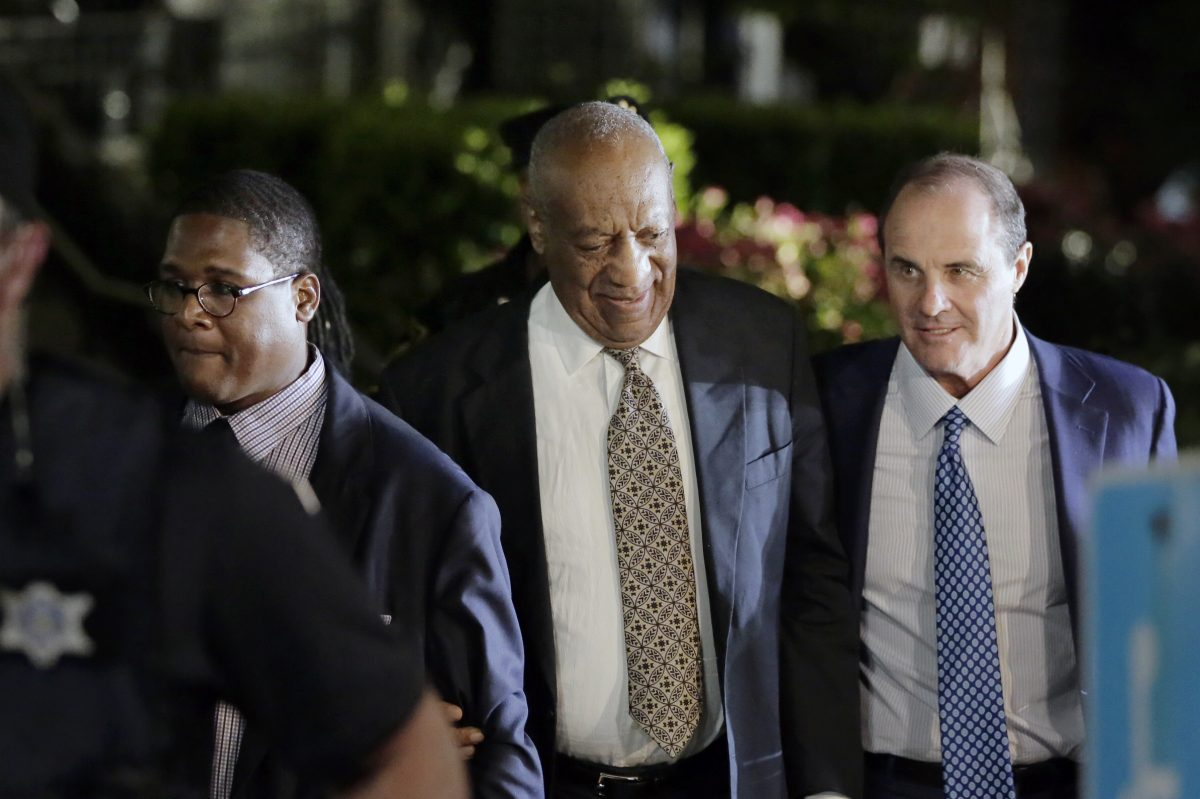 Bill Cosby (center) leaves the Montgomery County Courthouse in Norristown on June 15.