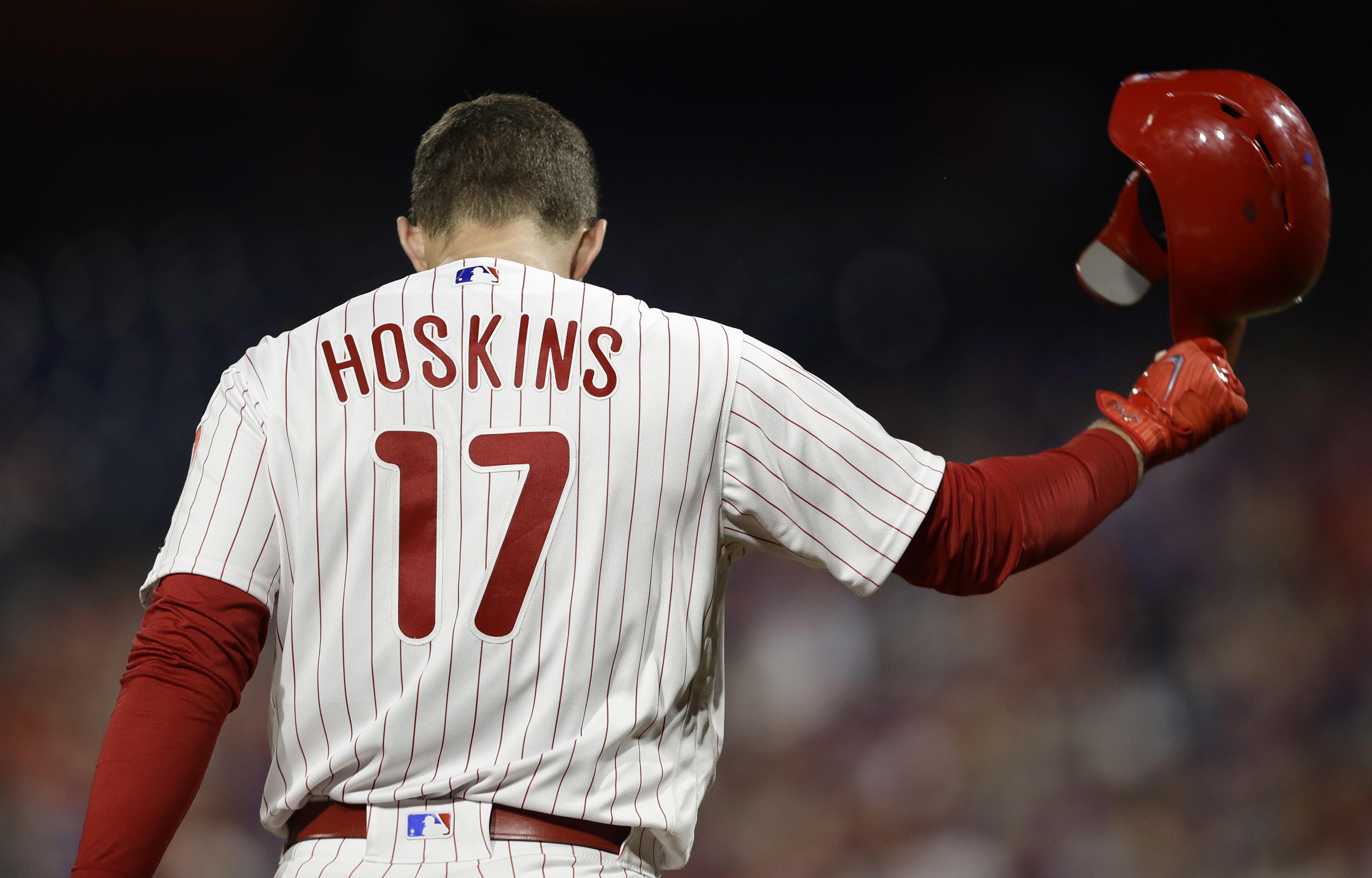 Philadelphia Phillies´ Rhys Hoskins tosses his helmet after pop-fouling out against Washington Nationals starting pitcher Stephen Strasburg during the fifth inning of a baseball game, Wednesday, Sept. 12, 2018, in Philadelphia. Washington won 5-1. (AP Photo/Matt Slocum)