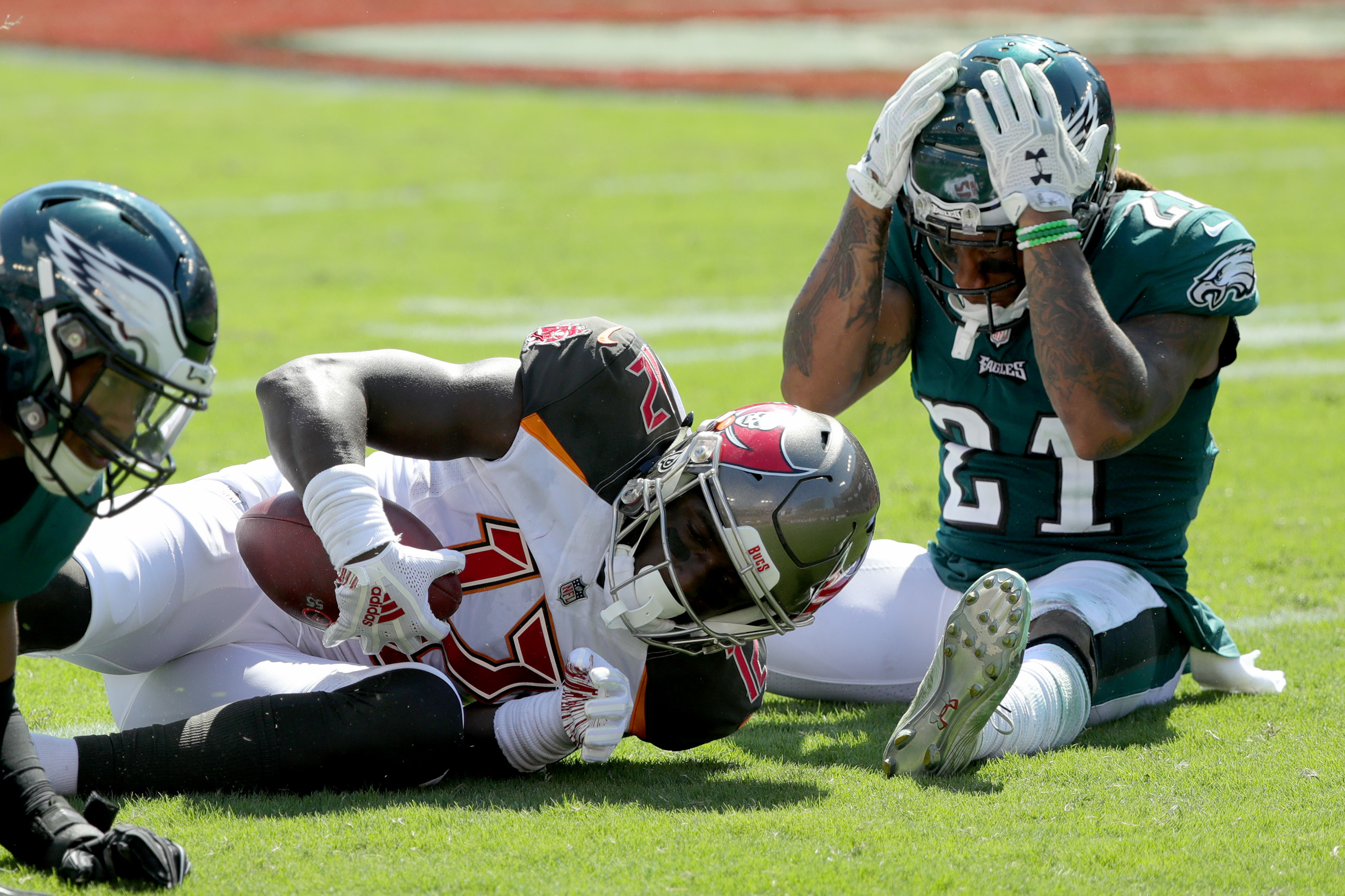 Ronald Darby right, reacts after the Buccaneers' Chris Godwin, center, makes a 1st down catch. Philadelphia Eagles lose 27-21 to the Tampa Bay Buccaneers in Tampa, Fl on September 16, 2018.
