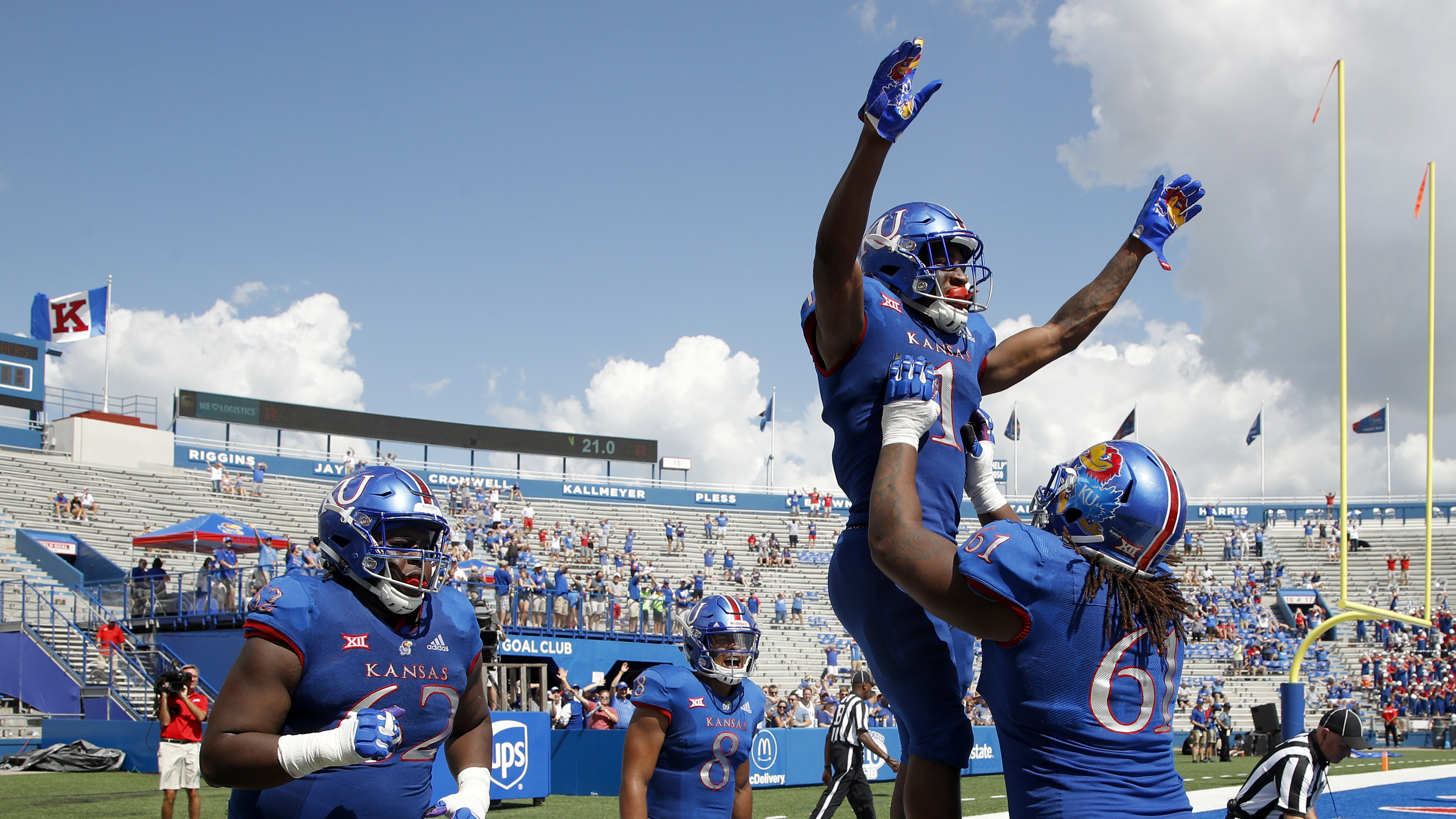 Kansas running back Pooka Williams Jr. (1) celebrates with teammates after scoring a touchdown in the rout of Rutgers.