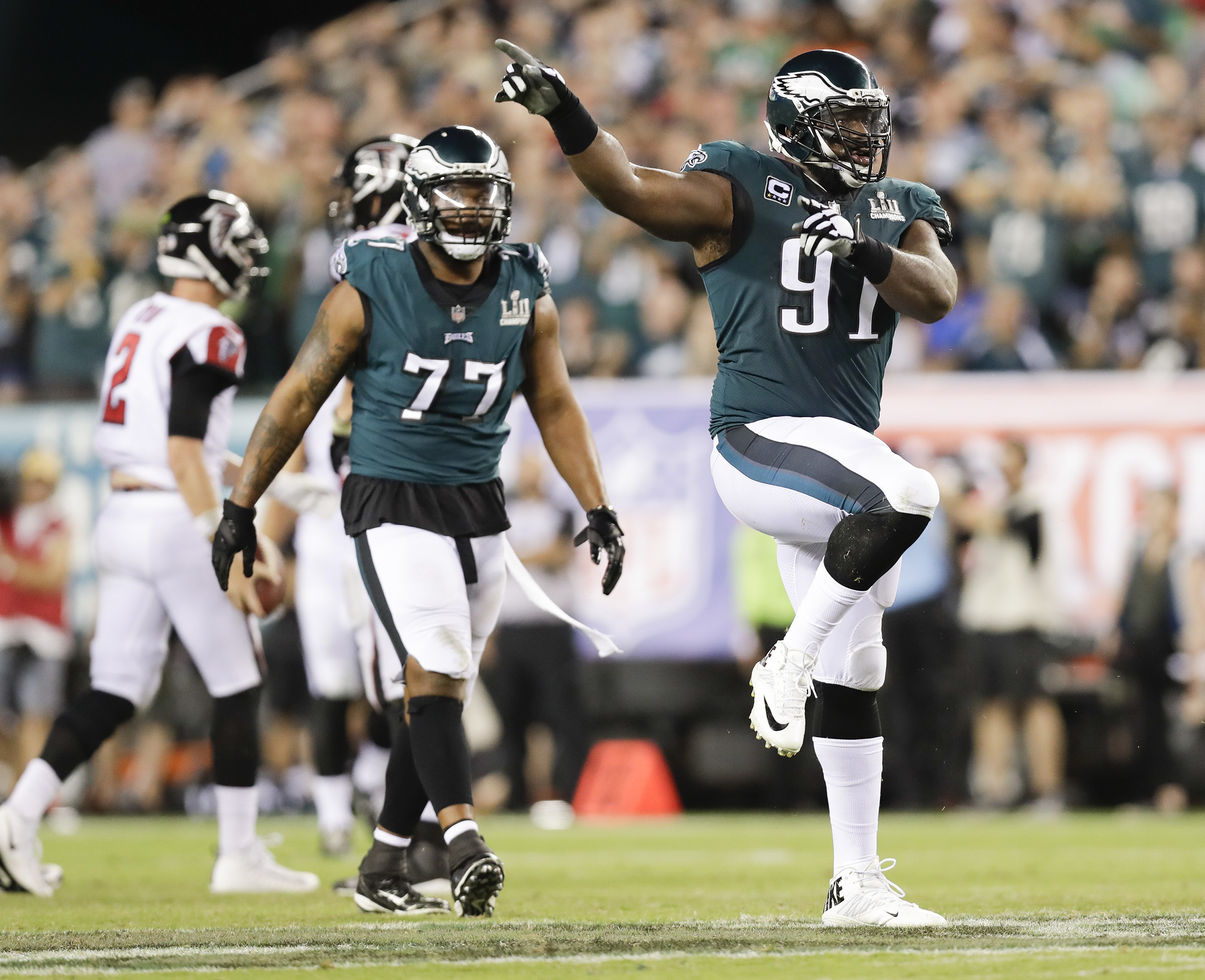Eagles defensive end Fletcher Cox celebrates after sacking Atlanta Falcons quarterback Matt Ryan as defensive end Michael Bennett watches Cox on Thursday, September 6, 2018. A penalty on the play was called on the Eagles.