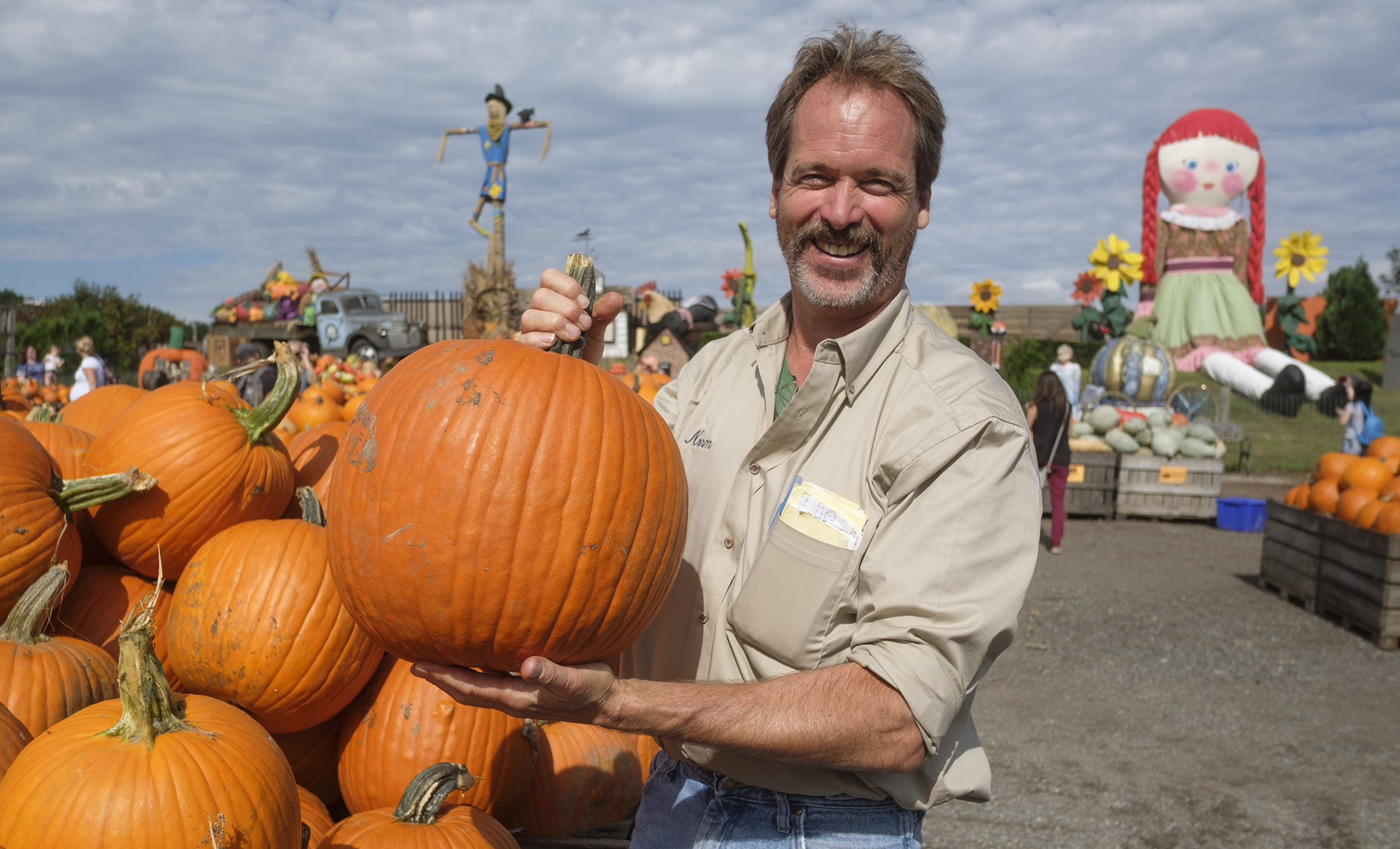 Farm manager Norm Schultz shows off a 20lb pumpkin in Pumpkinland at Linvilla Orchards.