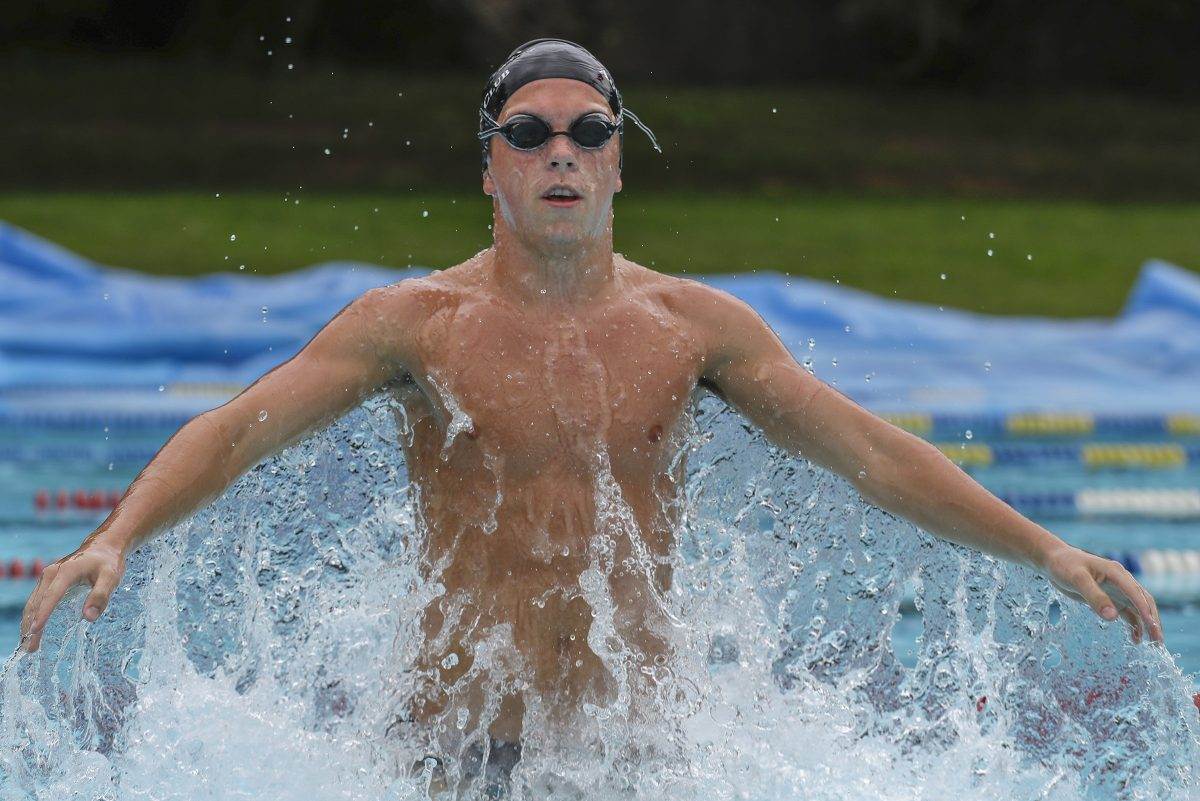 Germantown Academy sophomore Zach Kohm leaps out of the water during a practice .