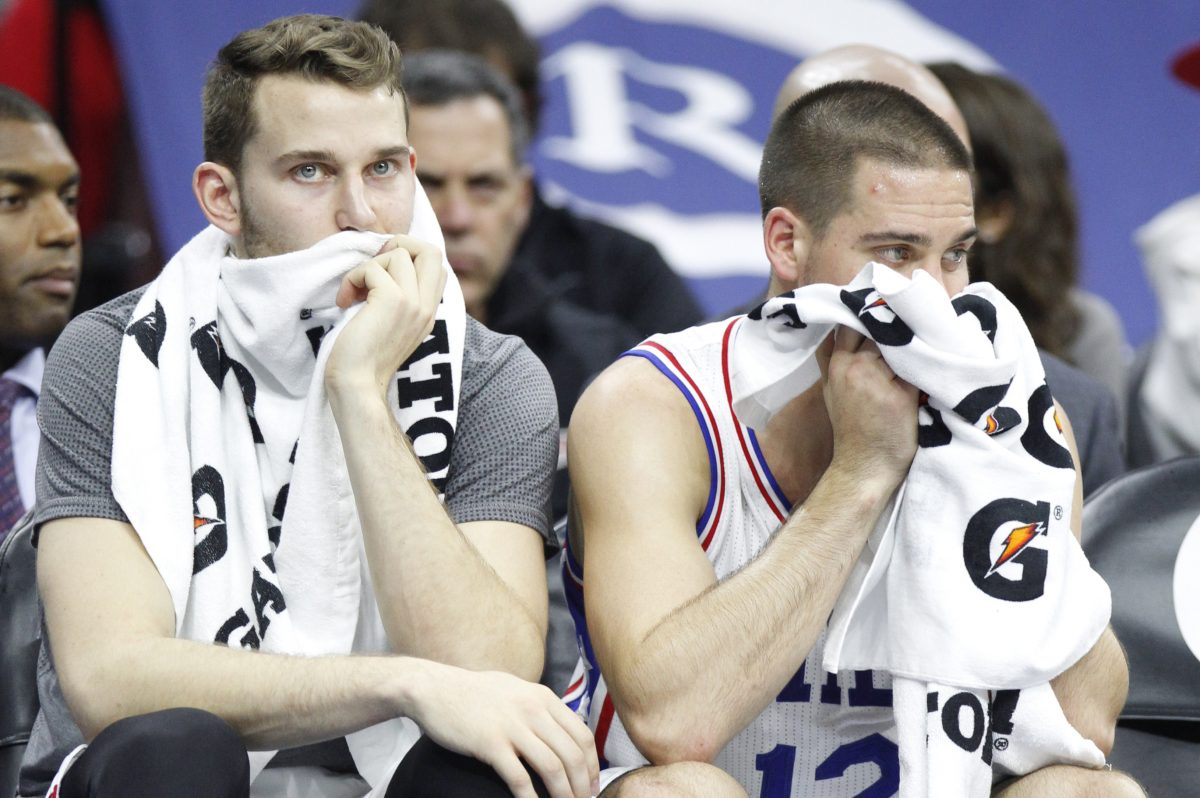 Sixers Nik Stauskas (left) and T.J. McConnell look dejected on the bench during a game in November 2015.