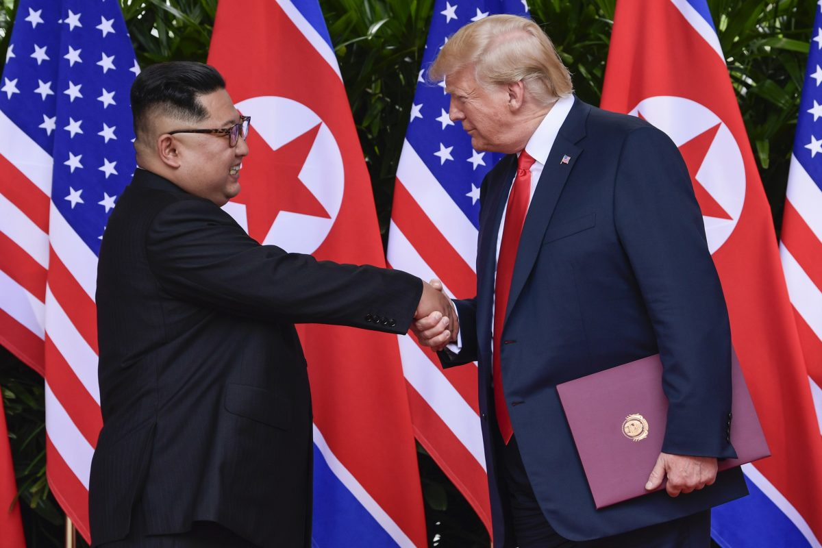 In this June 12, 2018, file photo, North Korean leader Kim Jong Un, left, and U.S. President Donald Trump shake hands at the conclusion of their meetings at the Capella resort on Sentosa Island in Singapore.