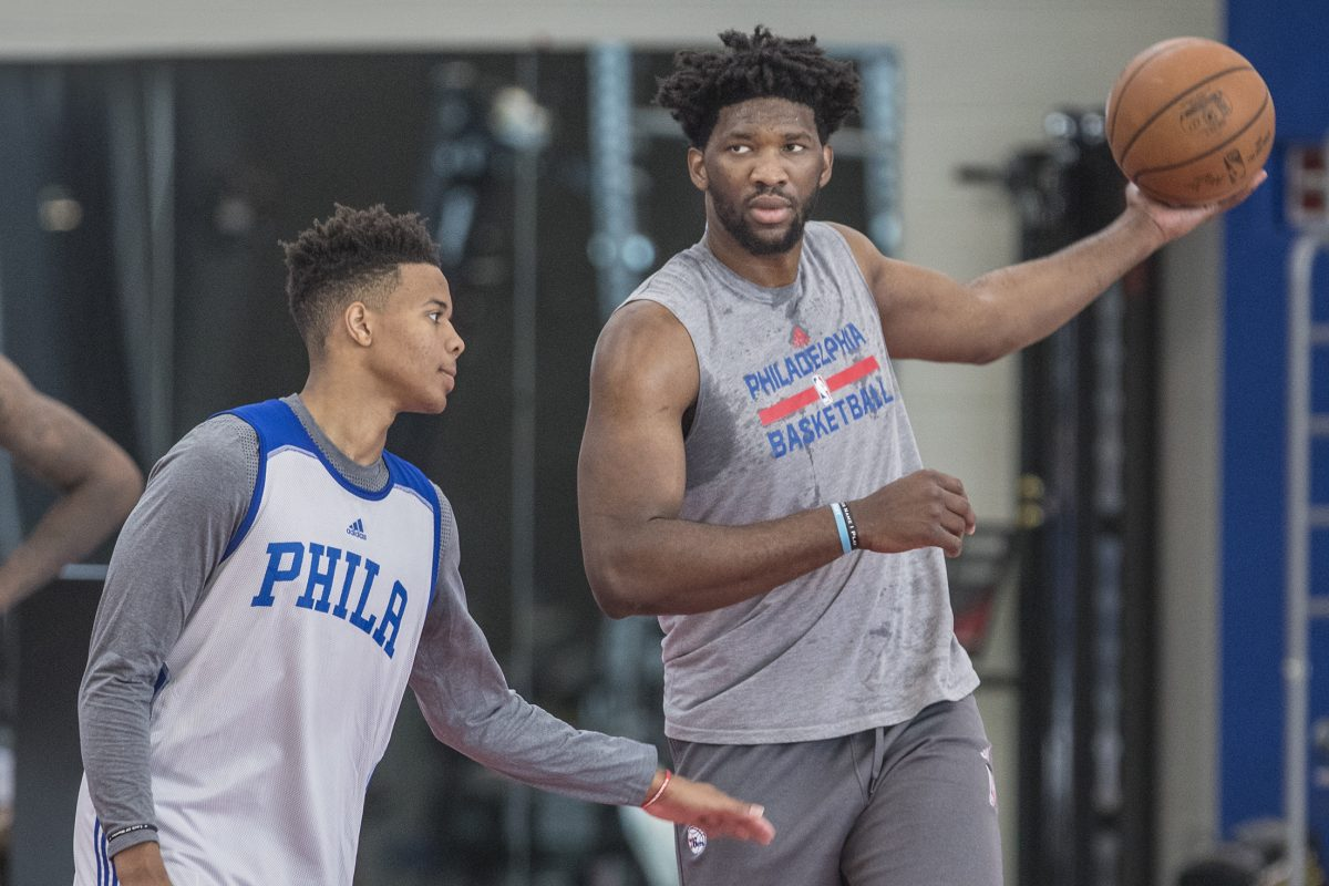 Joel Embiid playing keep-away from first-round draft pick Markele Fultz during rookie camp.