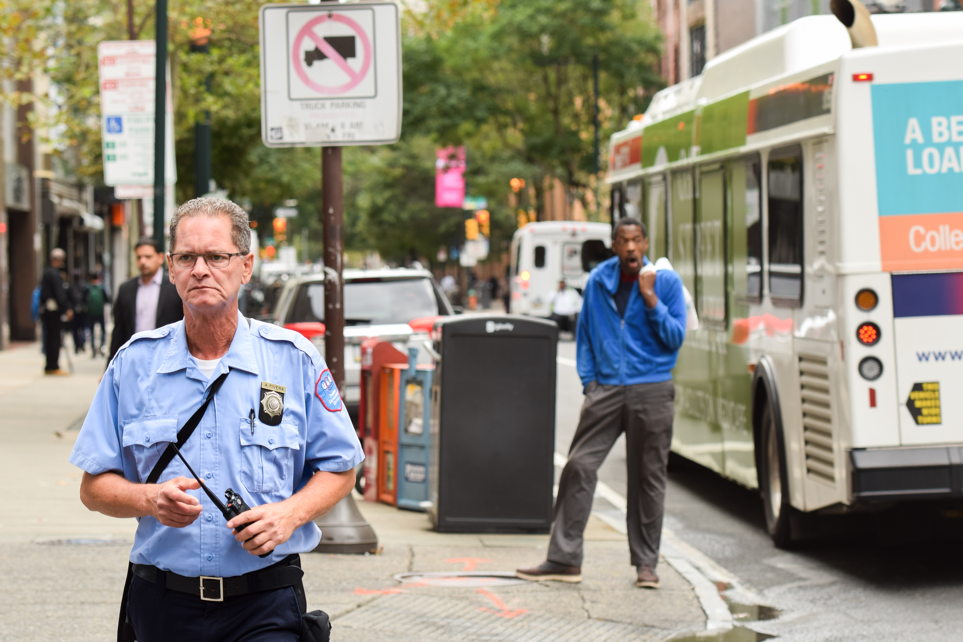 A Philadelphia Parking Enforcement Officer monitors drivers on the corners of 12th and Chestnut St. Monday morning.