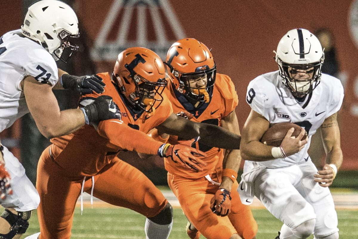 Penn State quarterback Trace McSorley (right) evades Illinois defenders during the first half of the Nittany Lions' 63-24 win on Friday.