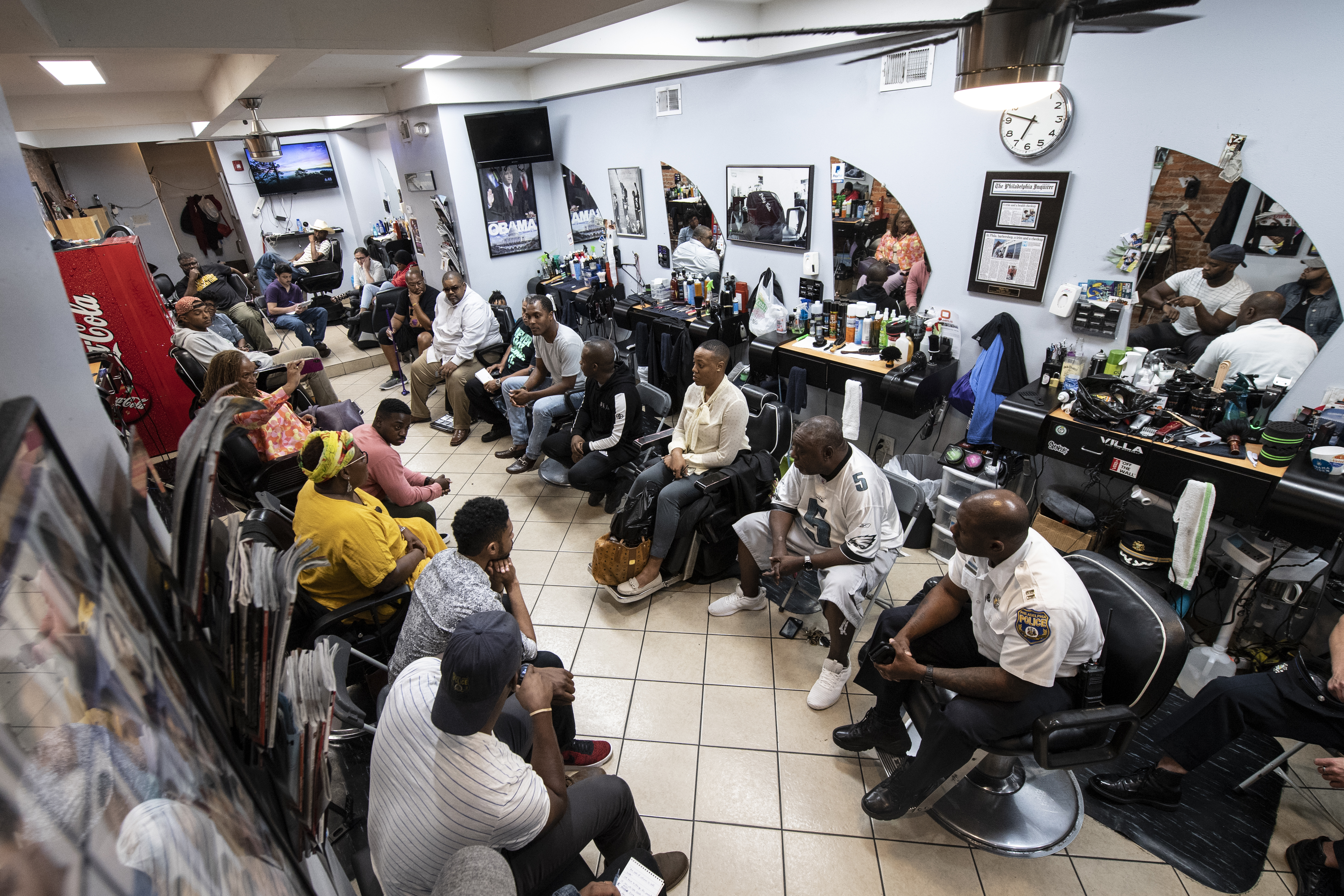 """Philadelphia Police and residents gather during a meeting called """"Blades, Fades, and Engage"""" at the Philly Cuts barbershop in Philadelphia, Pa. Monday, September 17, 2018. Stewart, organized the event at a West Philly barbershop where members of the community have an opportunity to chat directly with police officers. JOSE F. MORENO / Staff Photographer."""