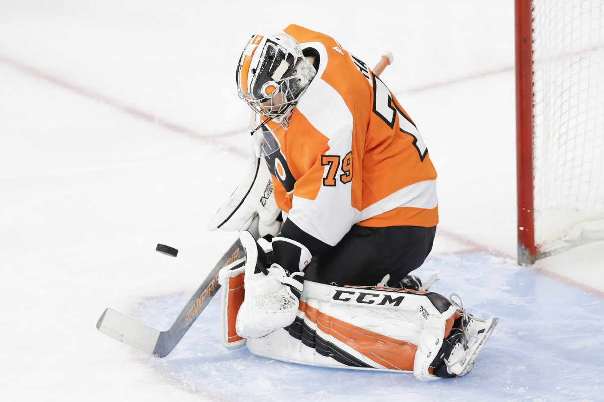 Flyers goalie Carter Hart makes a stop against the New York Islanders in a preseason game Friday. He has a .957 save percentage in the preseason.
