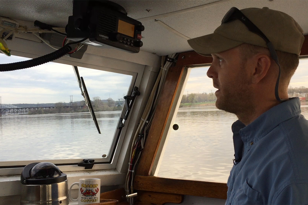 Captain Ian Robbins of the Chesapeake Bay Foundation pilots the Snowgoose near where the bay and Susquehanna River meet. April, 2017.