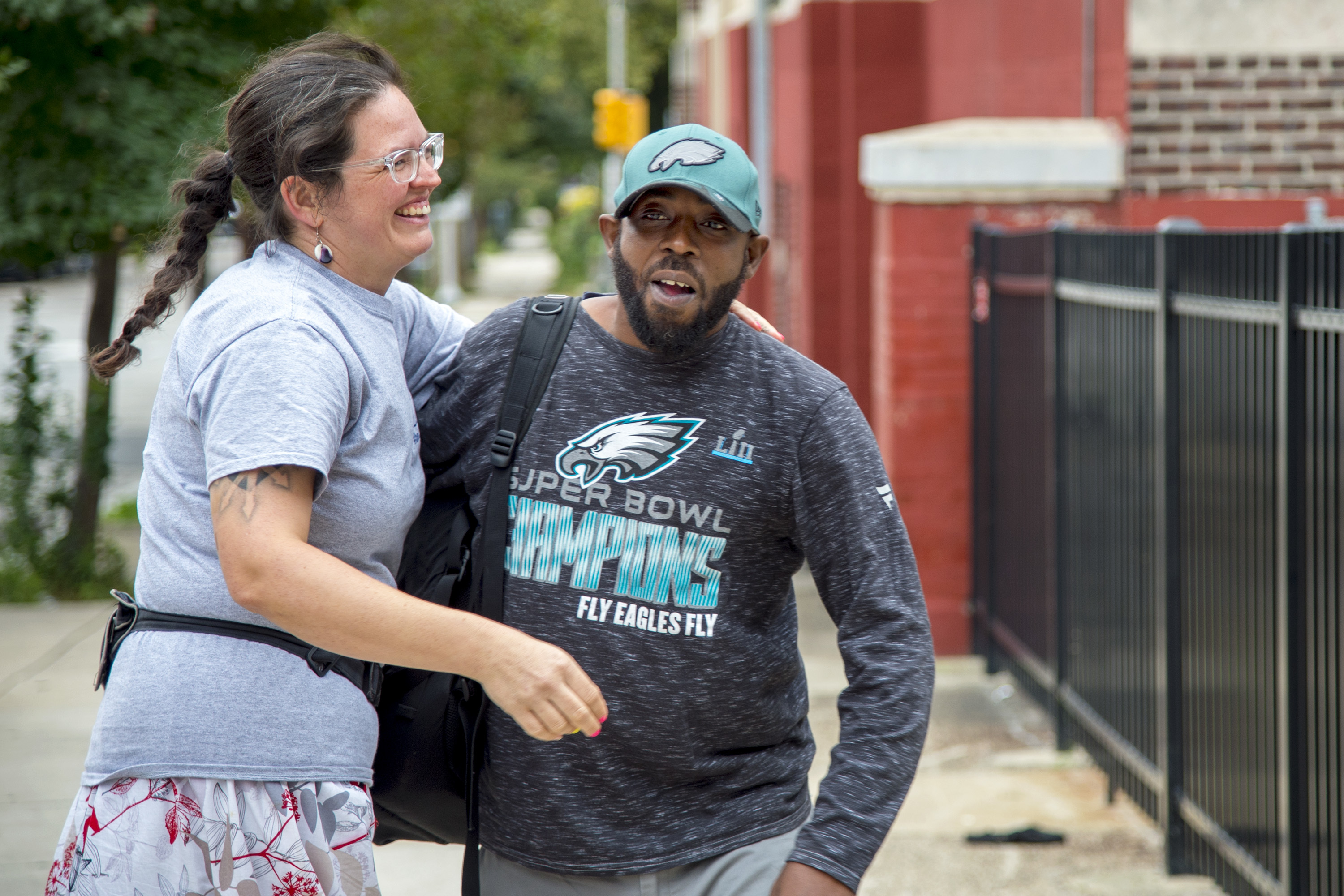 """Henry C. Lea Elementary School teacher Kitty Heite (left) greets school employee Anthony Brown outside the school. She is being forced to leave as the school undergoes """"leveling"""" - the shifting of teachers to other schools based on fluxes in enrollment."""