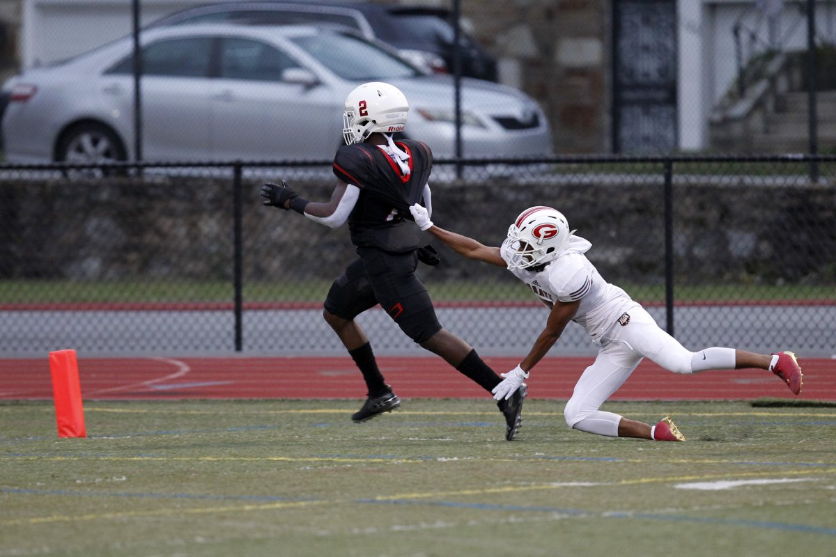 Imhotep Charter´s Tykee Smith (2) running for a TD as Simon Gratz´s Tawfiq Smalls tries to pull him down during the first half Friday.