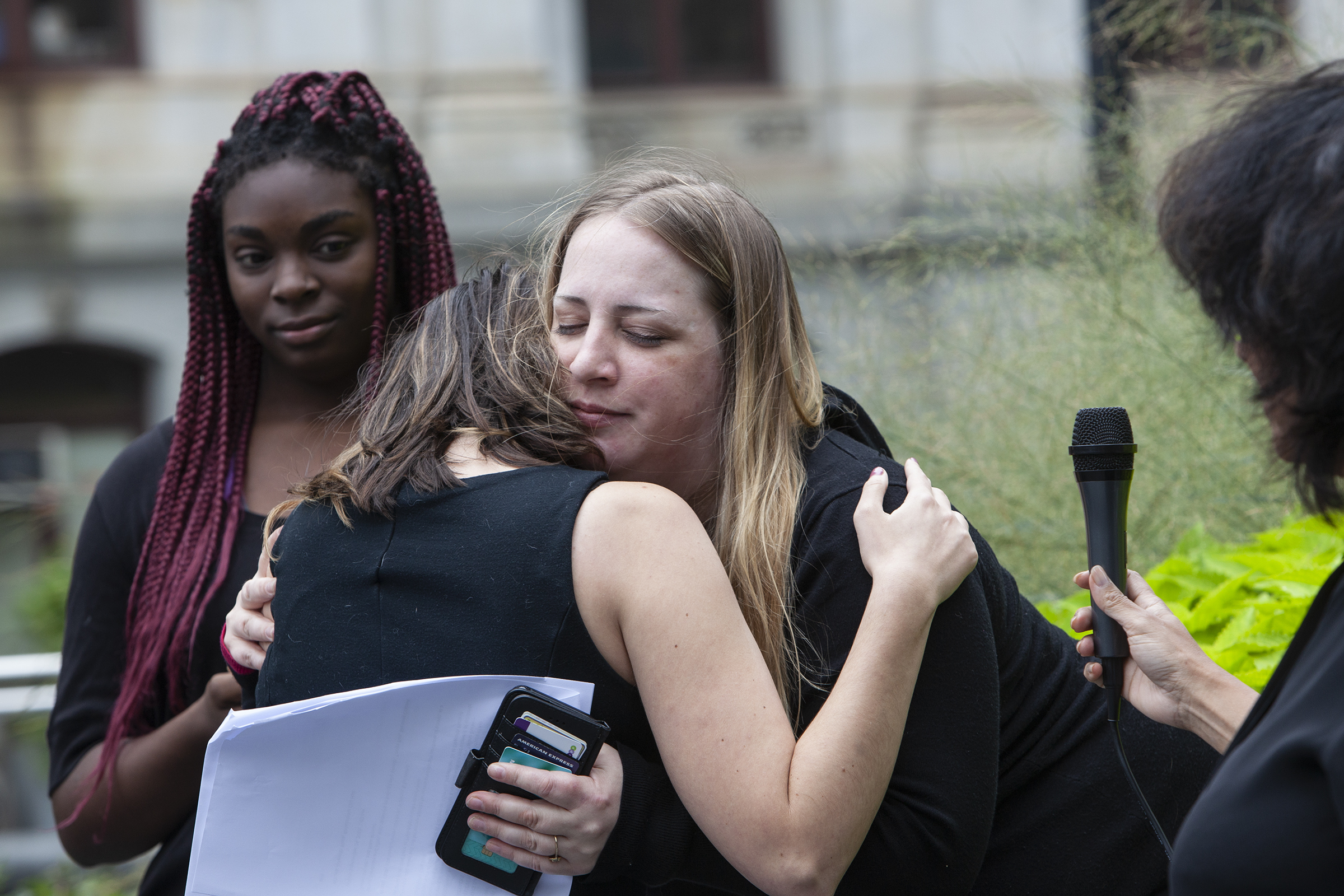 Gwen Snyder hugs Emily Woods following her speech to the crowd about her surviving sexual assault during a walkout for solidarity with Christine Blasey Ford, the Professor who accused Brett Kavanaugh of sexual assault, on Monday, Sept. 24, 2018. Survivors of sexual assault shared their stories with the crowd and called for the accountability of those in power who commit these assaults. The walkout is part of a nationwide movement that was called for by Tarana Burke, the founder of the #MeToo movement.