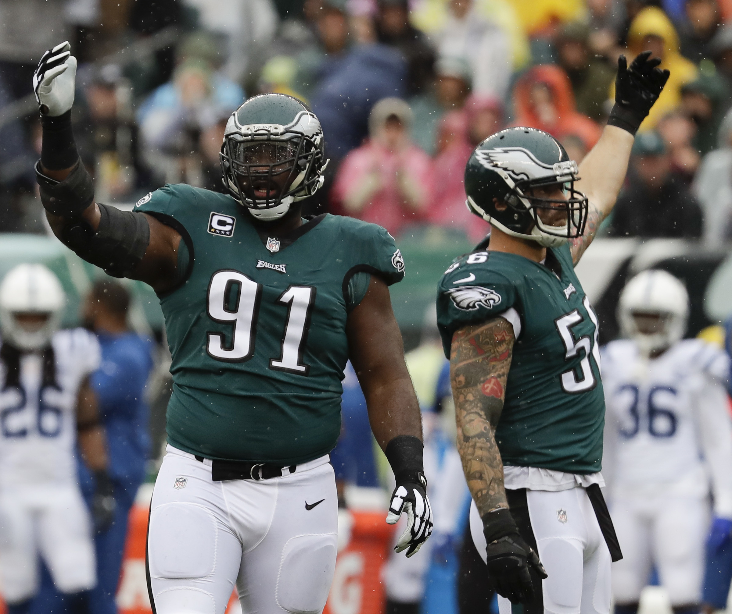 Eagles defensive end Fletcher Cox and defensive end Chris Long raise their arms during the game against the Colts.