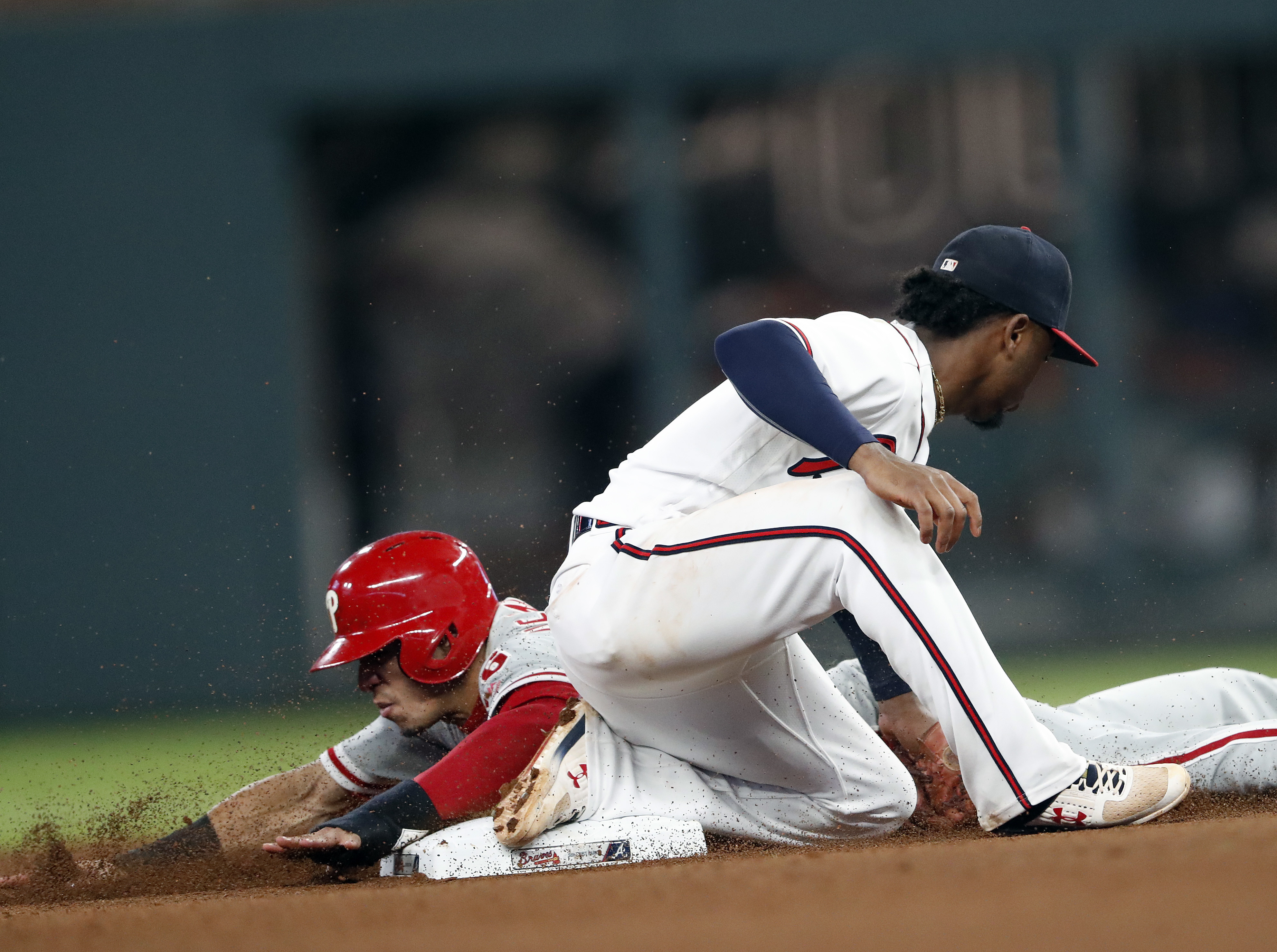 Cesar Hernandez is tagged out by Braves second baseman Ozzie Albies in an attempt to steal second during the seventh inning of the Phillies´ 8-3 loss to the Braves Thursday.