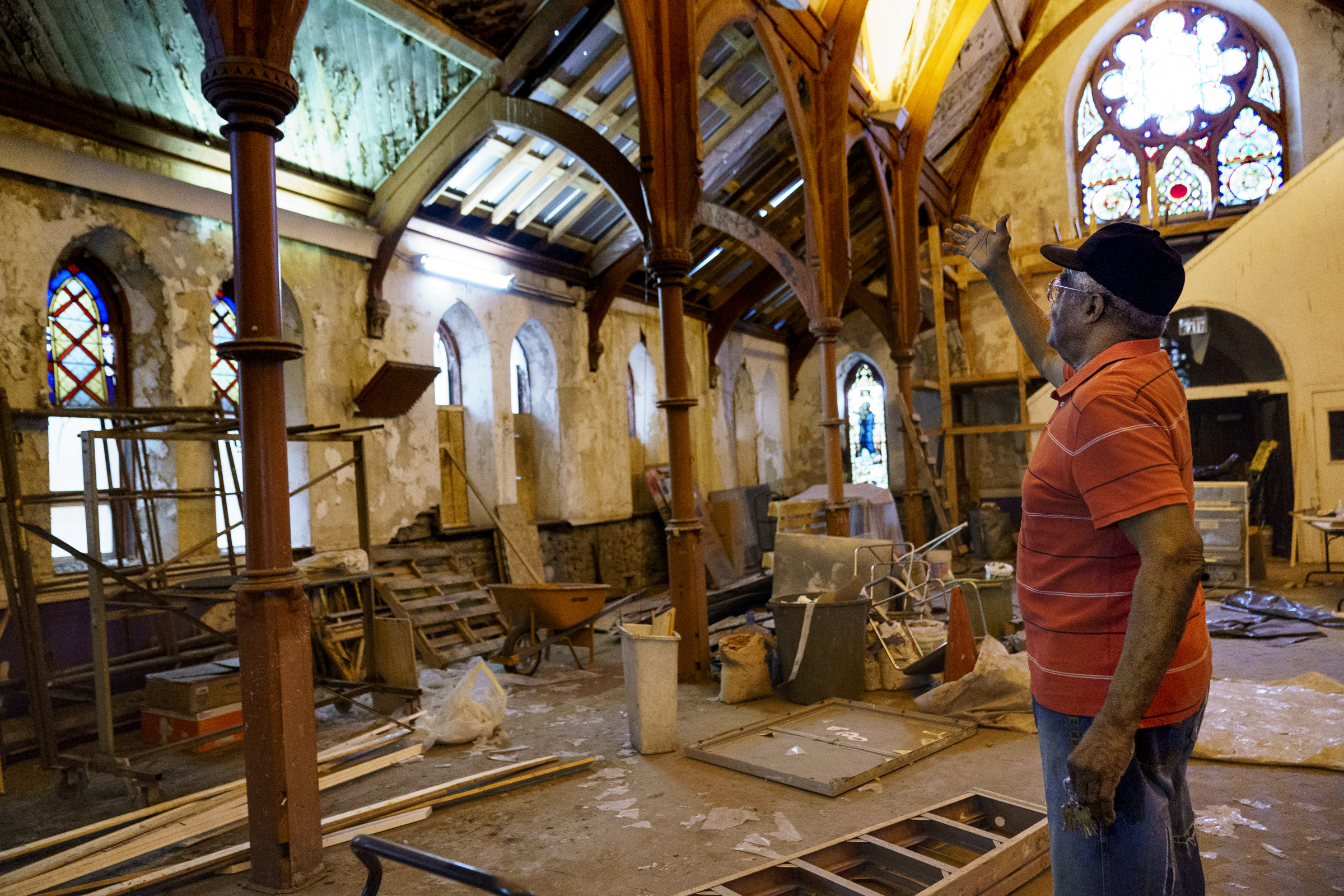 Deacon Lloyd Butler points to some of the work that the congregation and volunteers have completed in recent years to try to stave off future problems. While the sanctuary still has some structural issues, the adjoining fellowship hall is in better shape.