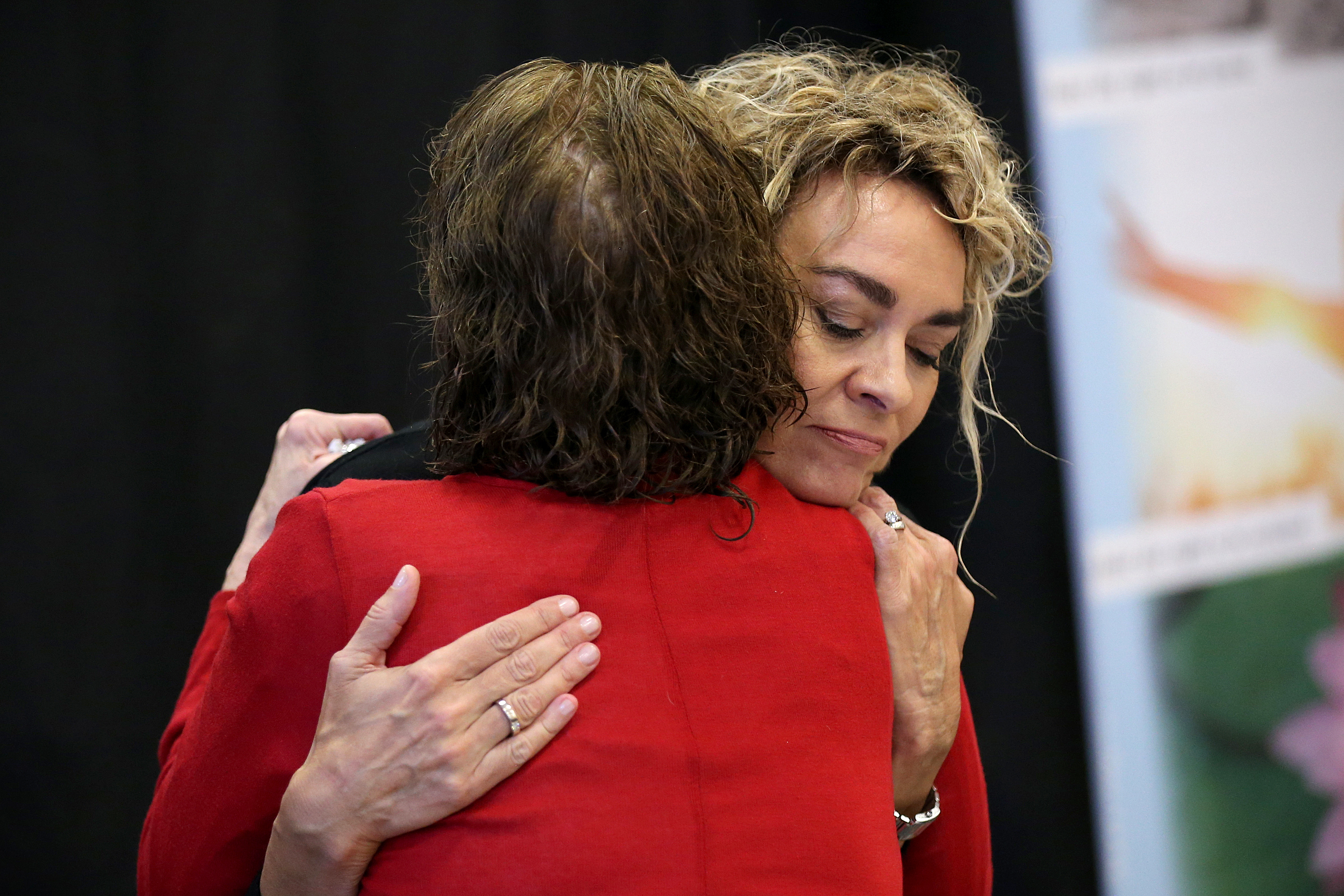 Bill Cosby accusers Sunni Welles, left, and Stacey Pinkerton embrace during a news conference with several other accusers at Savior Hall in Norristown Pa., on Tuesday, Sept. 25, 2018. Cosby was sentenced to prison for sexually assaulting Andrea Constand.