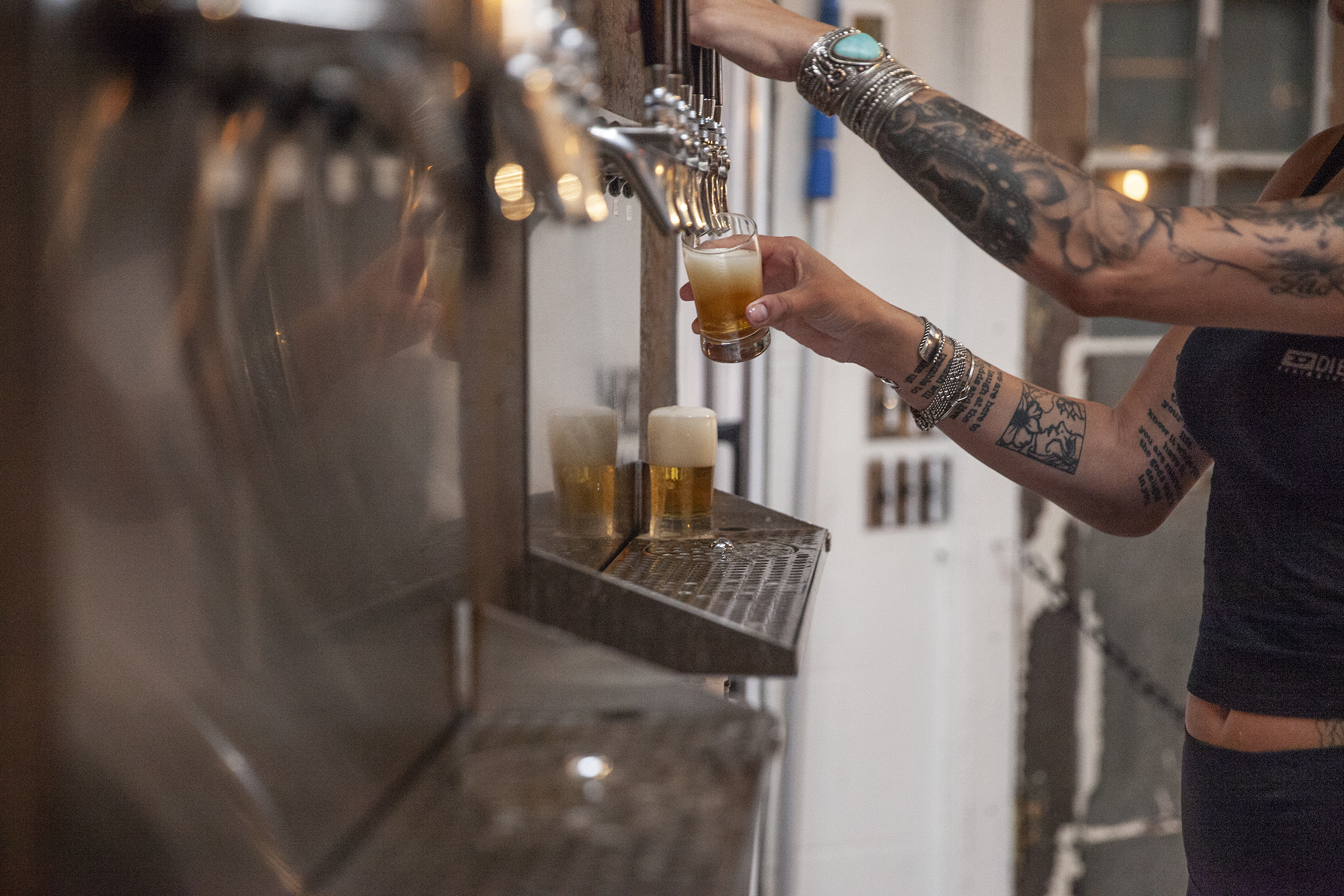 Bartenders fill up drinks at Love City Brewing, located at 1023 Hamilton, on Friday evening, Sept. 21, 2018.