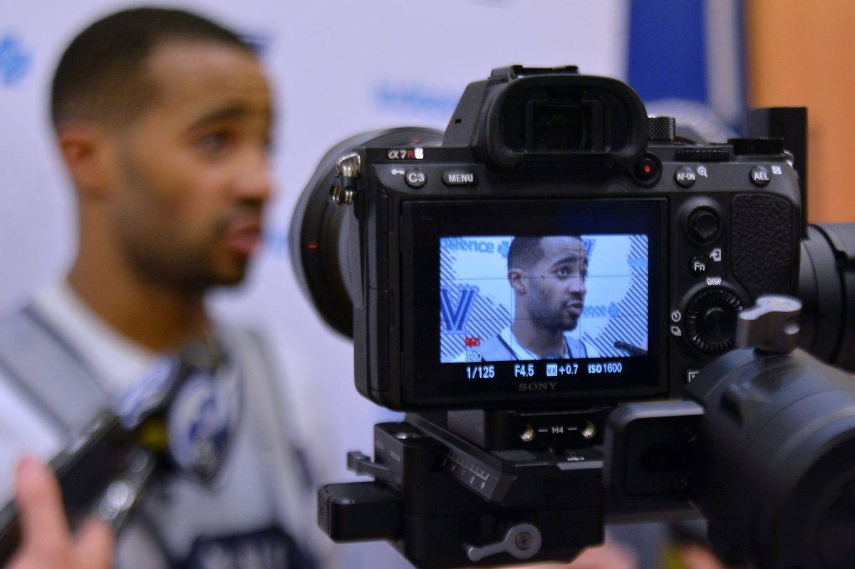 Villanova basketball player Phil Booth gets interviewed after a practice.