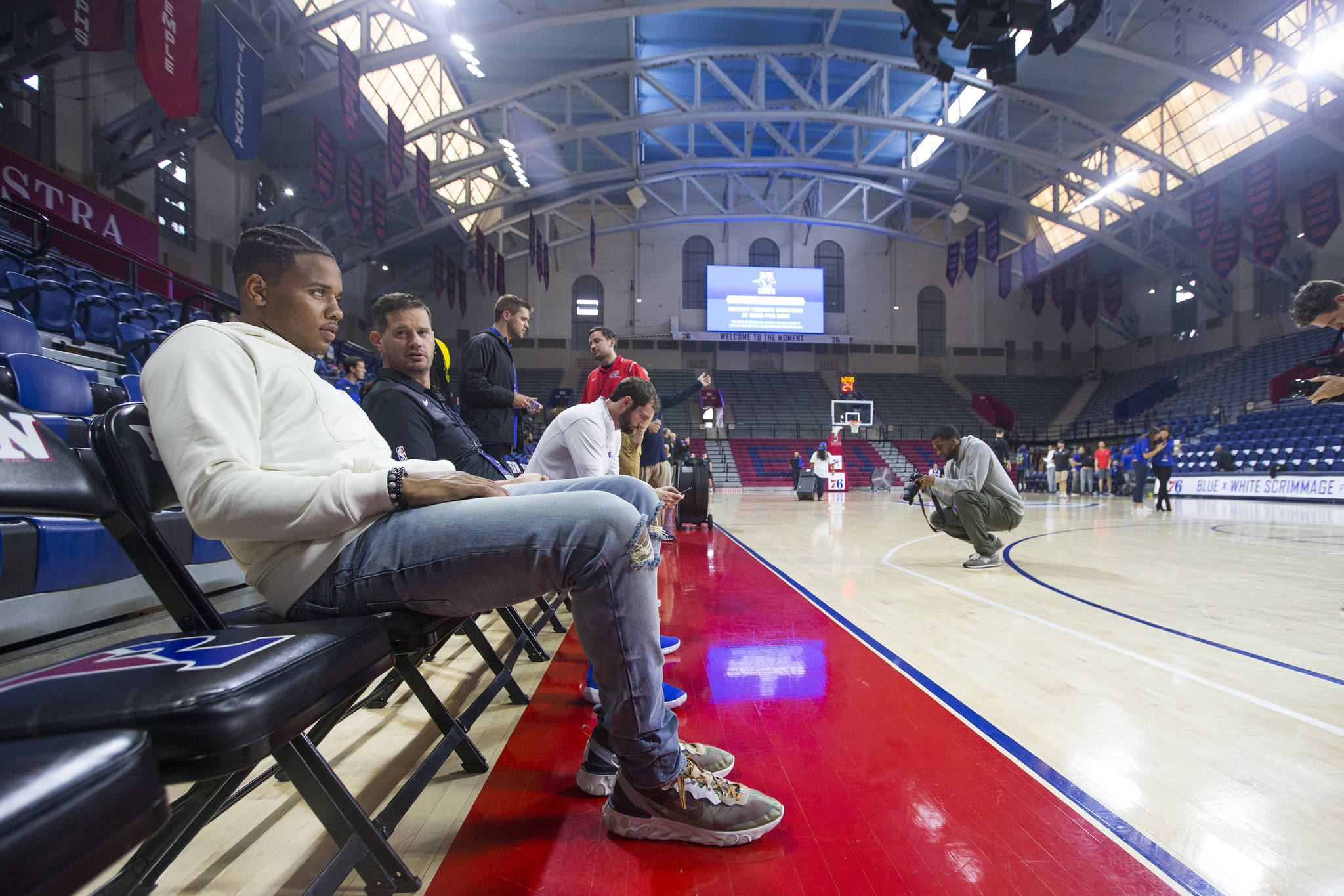 The Sixers Blue x White Scrimmage at the Palestra which is open to the public was cancelled due to a slippery court caused by condensation on Sept. 25, 2018. Markelle Fultz, left, of the Sixers sits courtside after the even was cancelled. CHARLES FOX / Staff Photographer