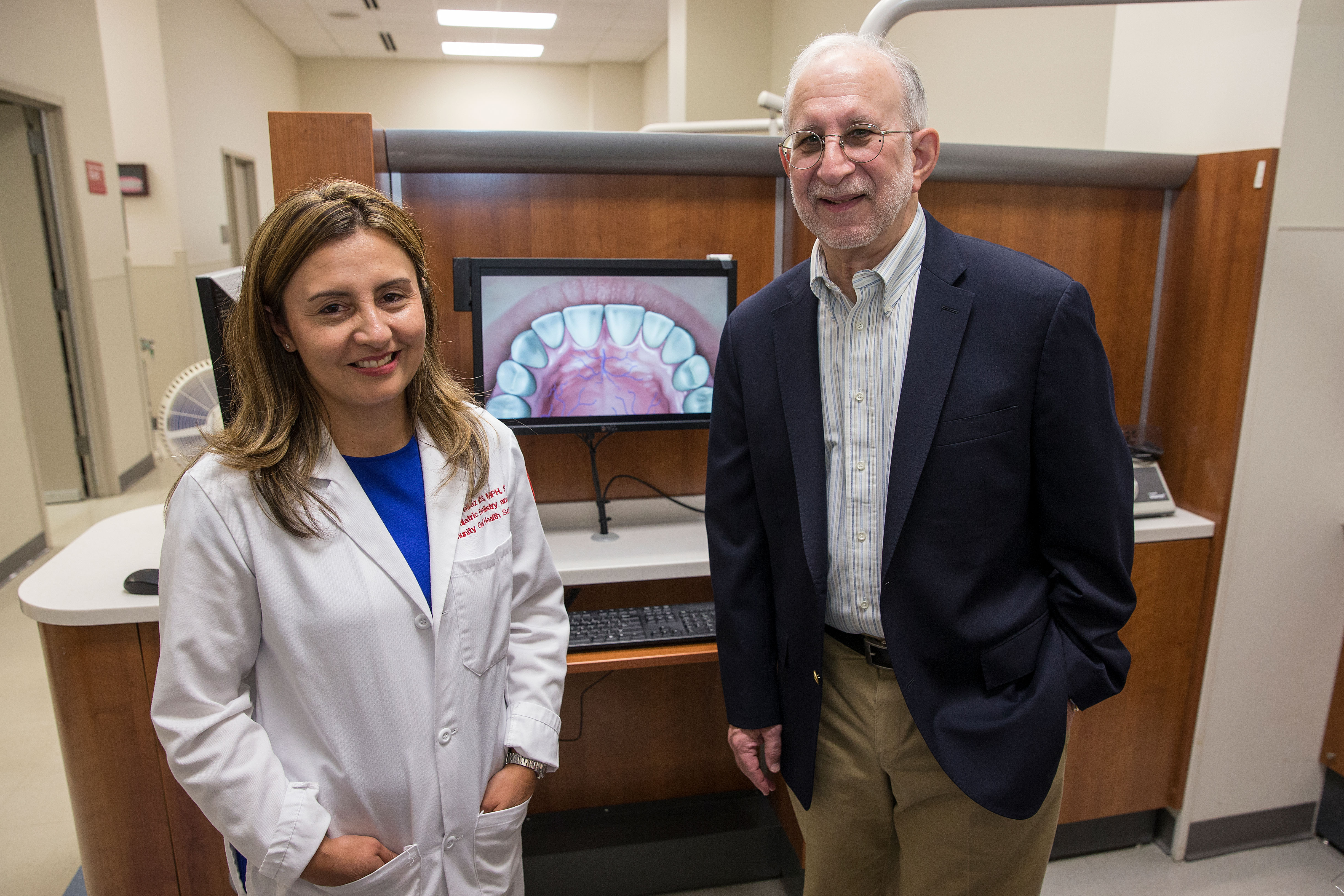 Temple researchers Marisol Tellez Merchán, right, associate professor at Temple University's Kornberg School of Dentistry, and Richard G. Heimberg, the Thaddeus L. Bolton Professor of Psychology in Temple's College of Liberal Arts, with the program they developed to help patients who have dental anxiety.