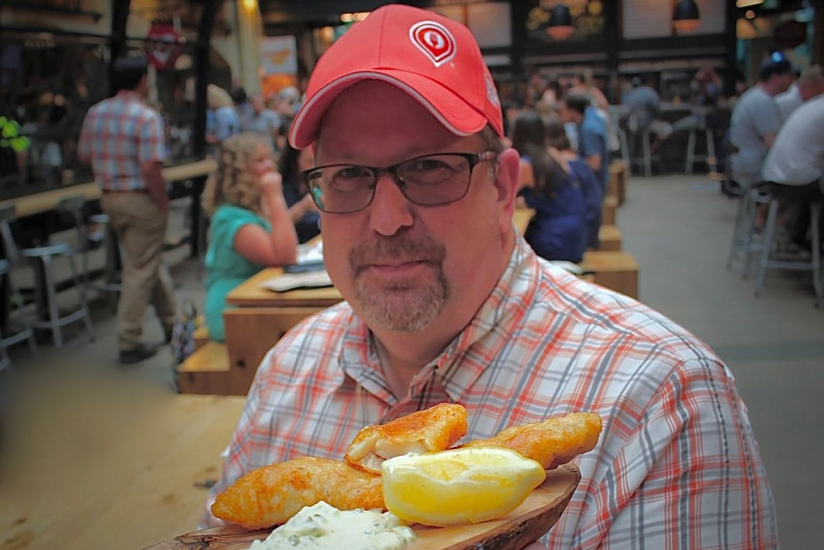Kevin Durkee, owner of Culinary Adventure Co., shows off some of Canada's best fried pickerel  at  Forks market in  Winnipeg.