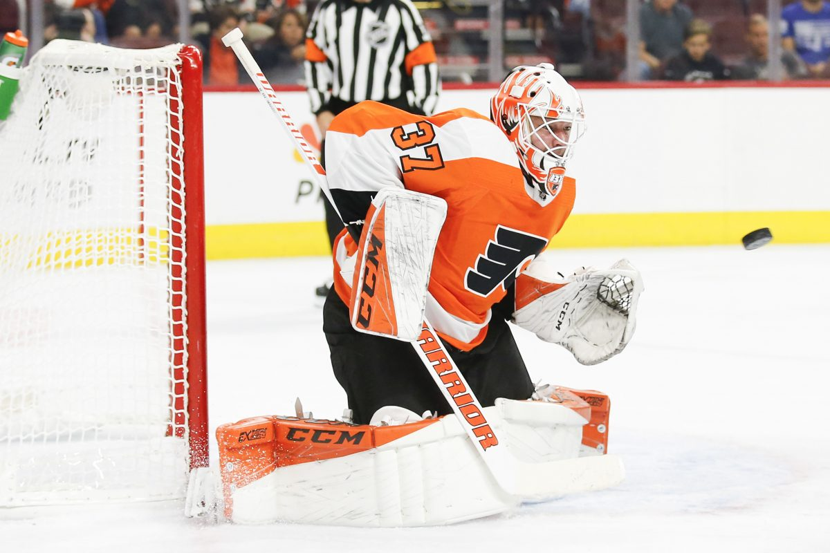 Flyers goaltender Brian Elliott watches the puck against the Bruins in a preseason game on Monday.