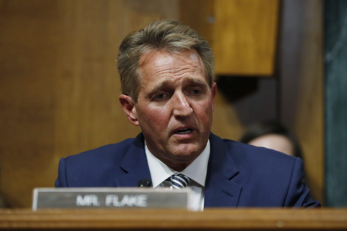 Sen. Jeff Flake, R-Ariz., speaks before the Senate Judiciary Committee hearing about an investigation, Friday, Sept. 28, 2018, on Capitol Hill in Washington.