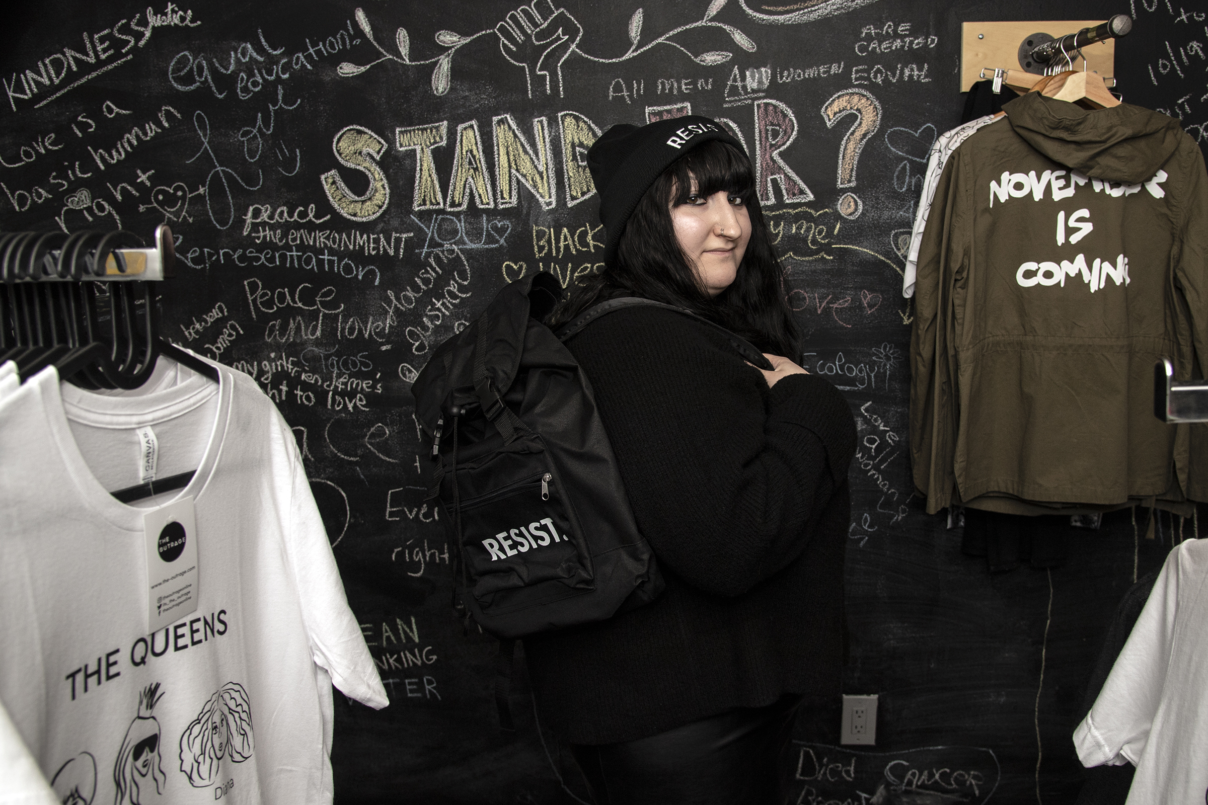 Carly Shapiro shows some of the protest merchandise at The Outrage/ store located on 321 Arch Street, Philadelphia. Monday, October 22, 2018. JOSE F. MORENO / Staff Photographer.