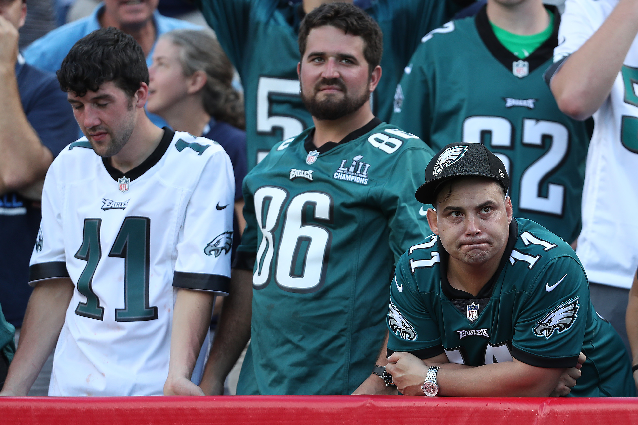 Eagles fans watch as the Titans finish off their game-winning overtime drive in the Birds� 26-23 loss Sunday.