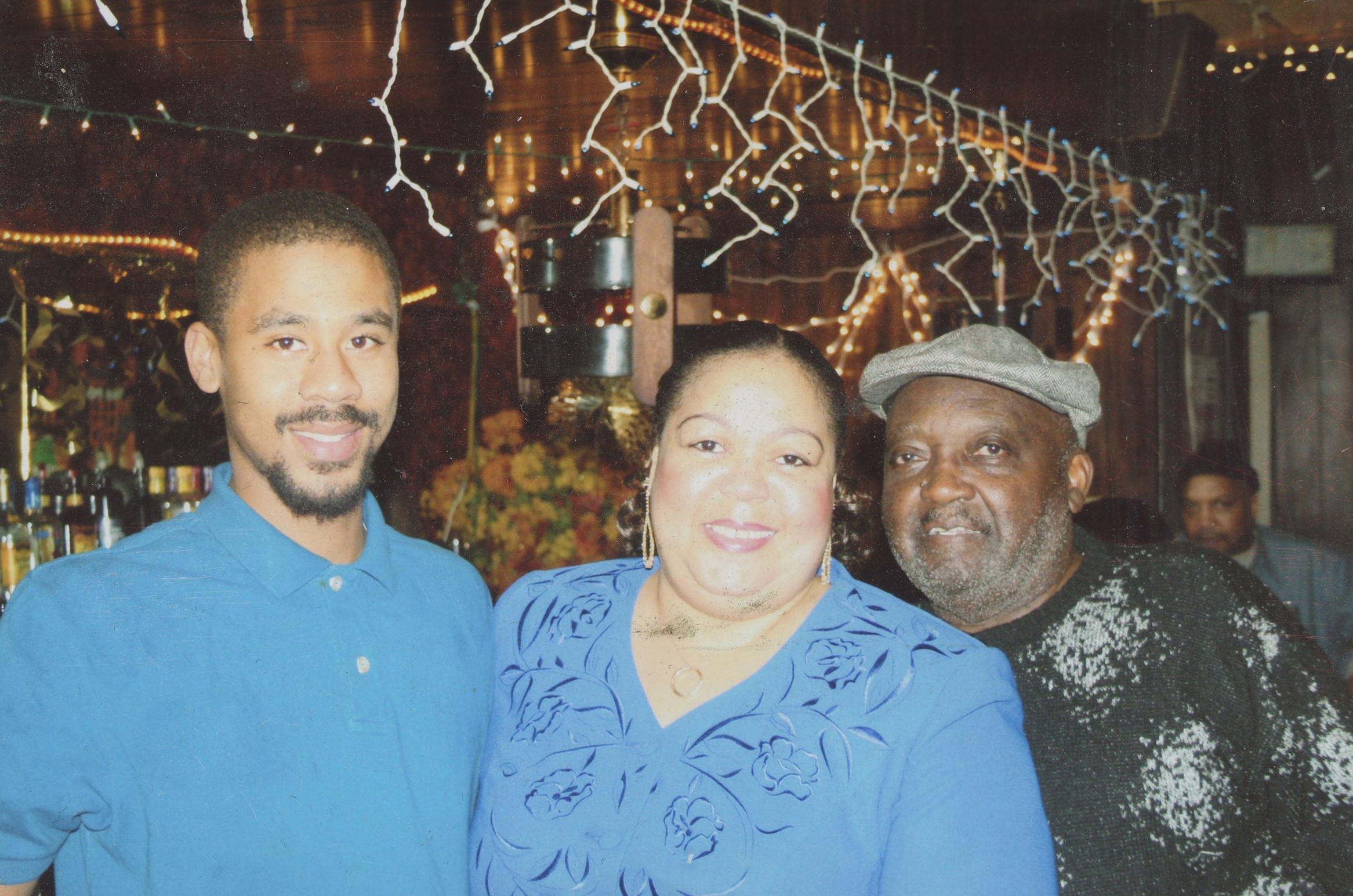 Homicide victim Jonathan Pitts, left, with his mother Gwen Pitts and stepfather Fred Ford, in an undated photo.