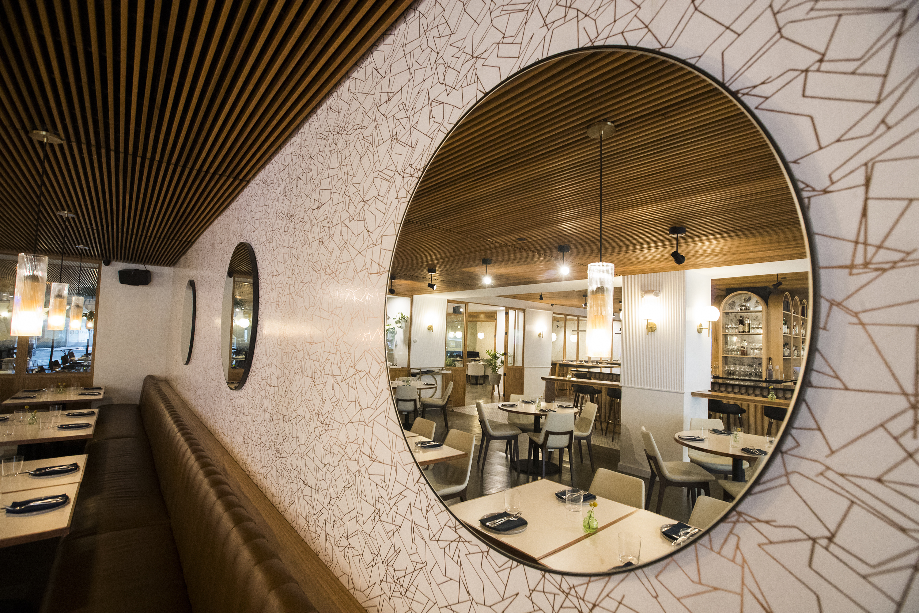 The dining room at Spice Finch is reflected in a mirror.