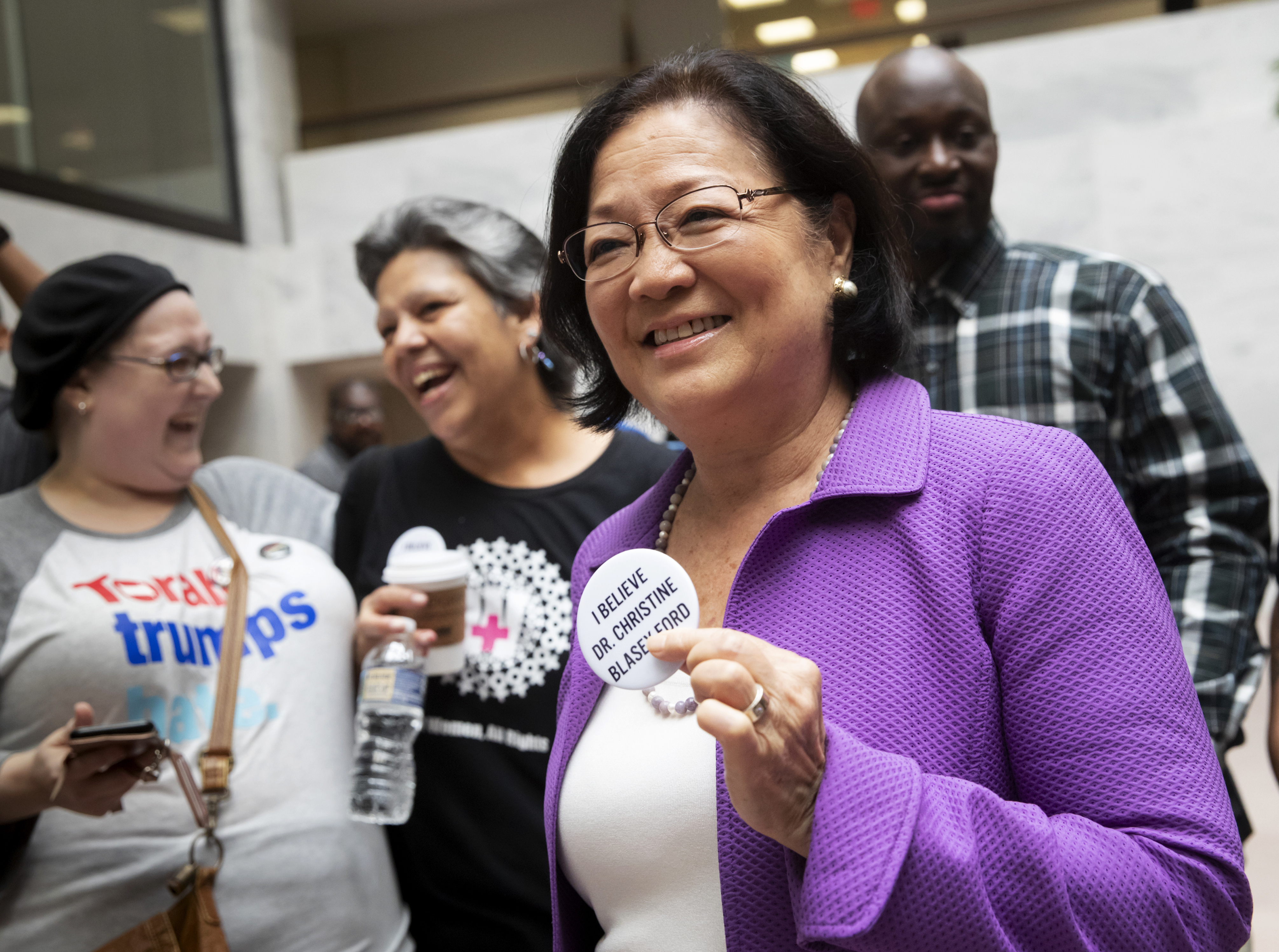 Sen. Mazie Hirono, D-Hawaii, a member of the Senate Judiciary Committee, is welcomed by protesters opposed to President Donald Trump´s Supreme Court nominee, Brett Kavanaugh, as they demonstrate in the Hart Senate Office Building on Capitol Hill last month.