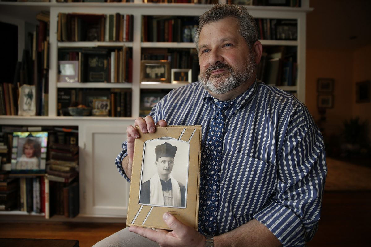 Plastic surgeon Aron D. Wahrman says working with veterans is especially meaningful to him in light of the fact that American soldiers liberated his father (shown in the photo he is holding) from a Nazi prison camp.