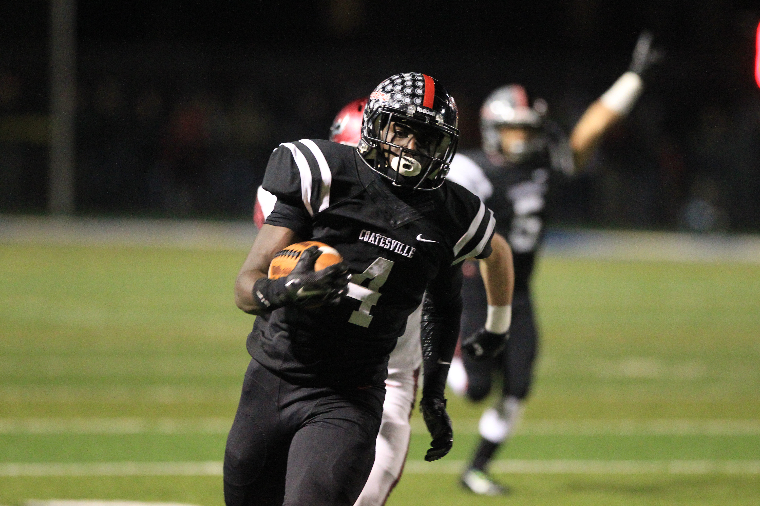 Coatesville´s Aaron Young runs for a long gain against St. Joseph's Prep in last season´s PIAA Class 6A state semifinal.
