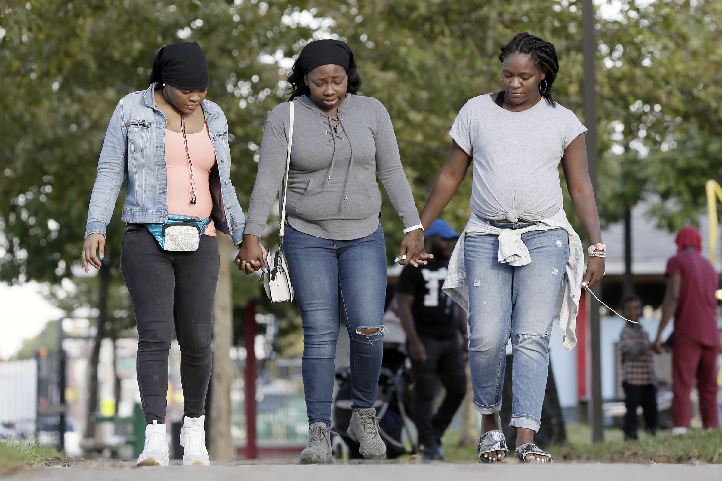 """(From left to right) Tye´Chelle Hall, Alize Grifin and Quadiyah Burton mourn the loss of their friend, Dawn """"Sissy"""" Boyd, as they walk in the Shepard Recreation Center in West Philly on Oct. 3, 2018. Boyd was killed in a drive-by shooting in West Philadelphia last week."""