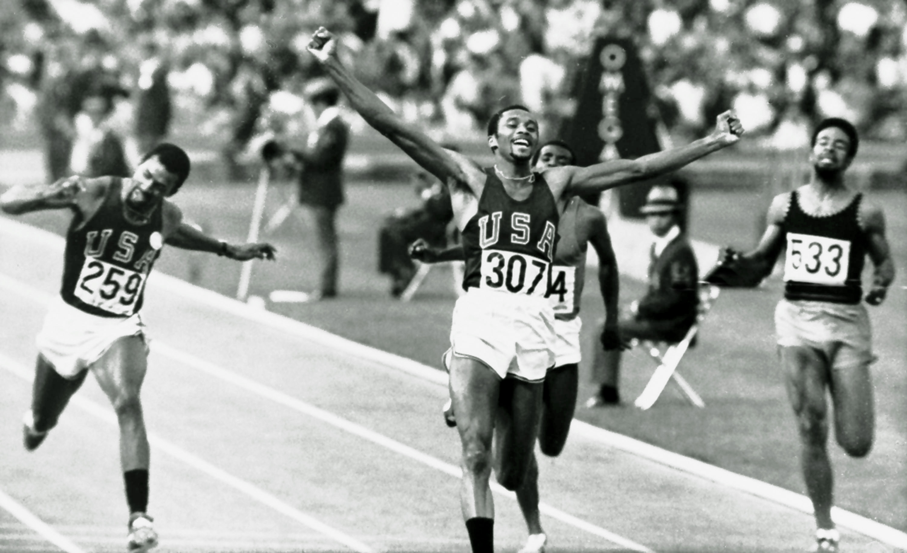 Tommie Smith of the U.S. raises his arms as he wins the 200-meter dash at the 1968 Olympics in Mexico City.