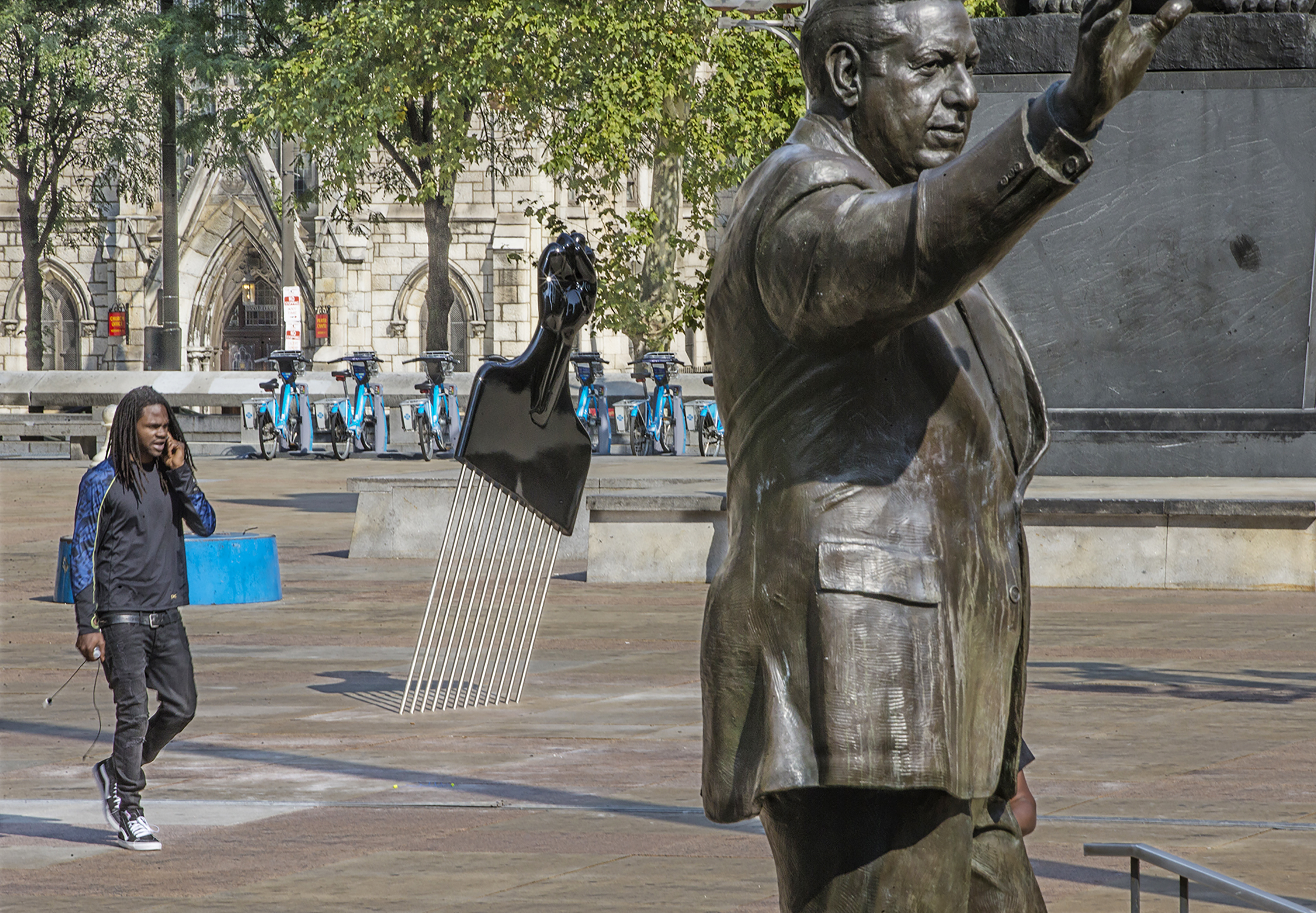 """The statue of Frank Rizzo and """"All Power to All People,"""" seen together last fall."""