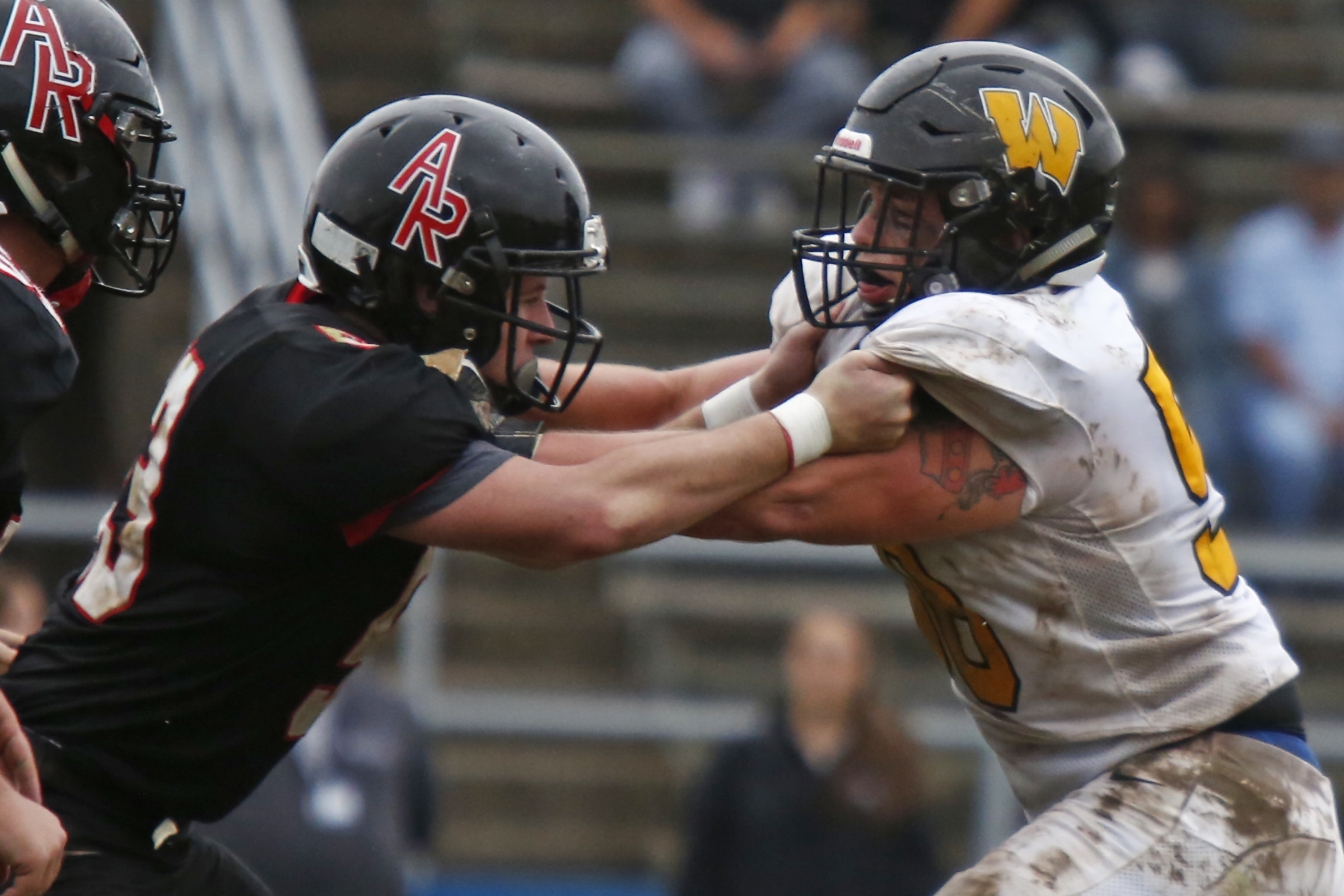 Archbishop Wood defensive lineman Connor Bishop (right) battles Archbishop Ryan offensive lineman Chris Brown during the third quarter of a Catholic League Red Division football game Saturday, Oct. 6, 2018, at George Washington. Wood went on to win, 27-7.
