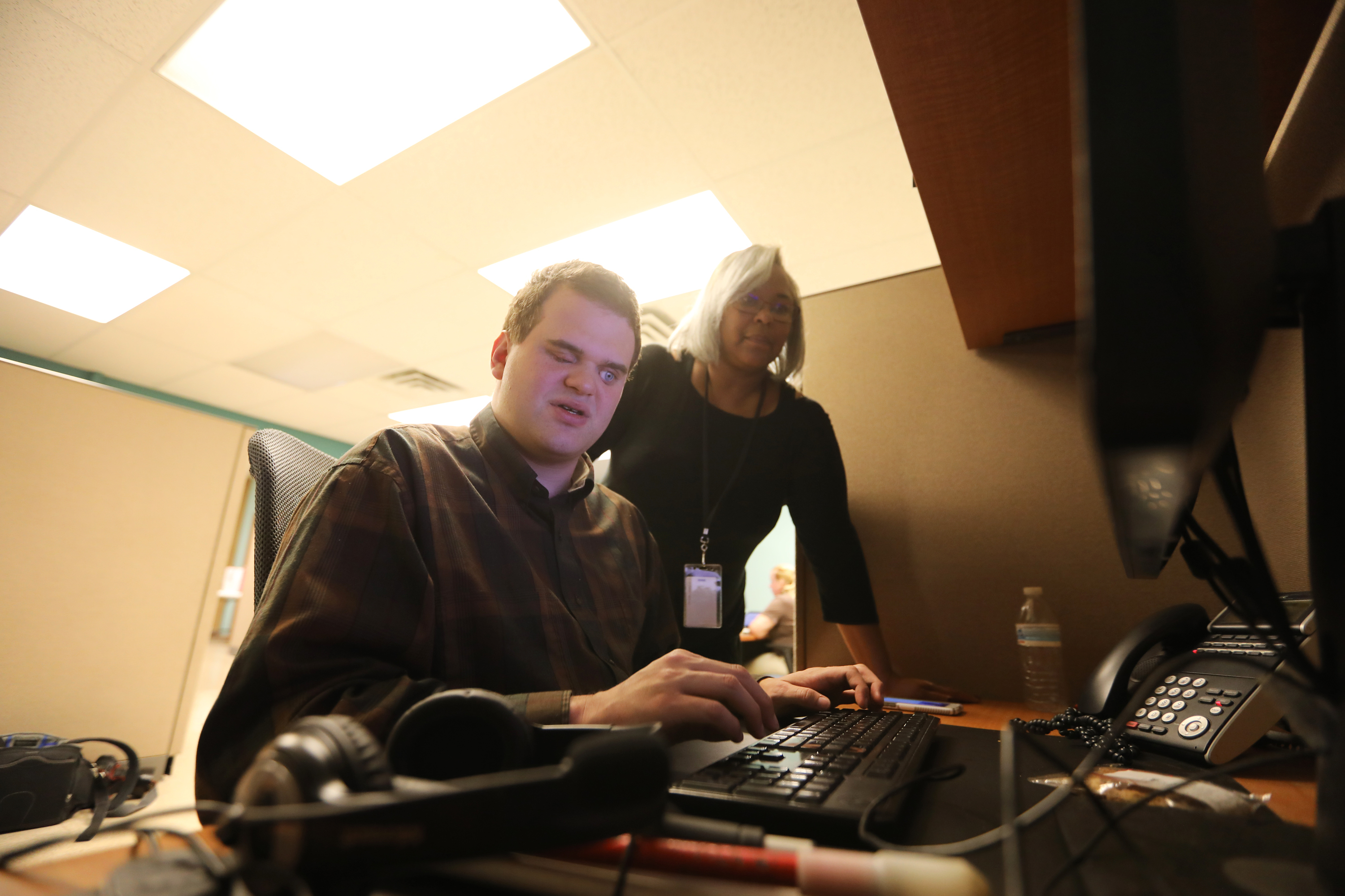 Matt Wallace at work on the computer at VisionCorps. Director of Services Carolyn Madison says her blind employees are the most reliable she´s had in decades of handling government contracts.
