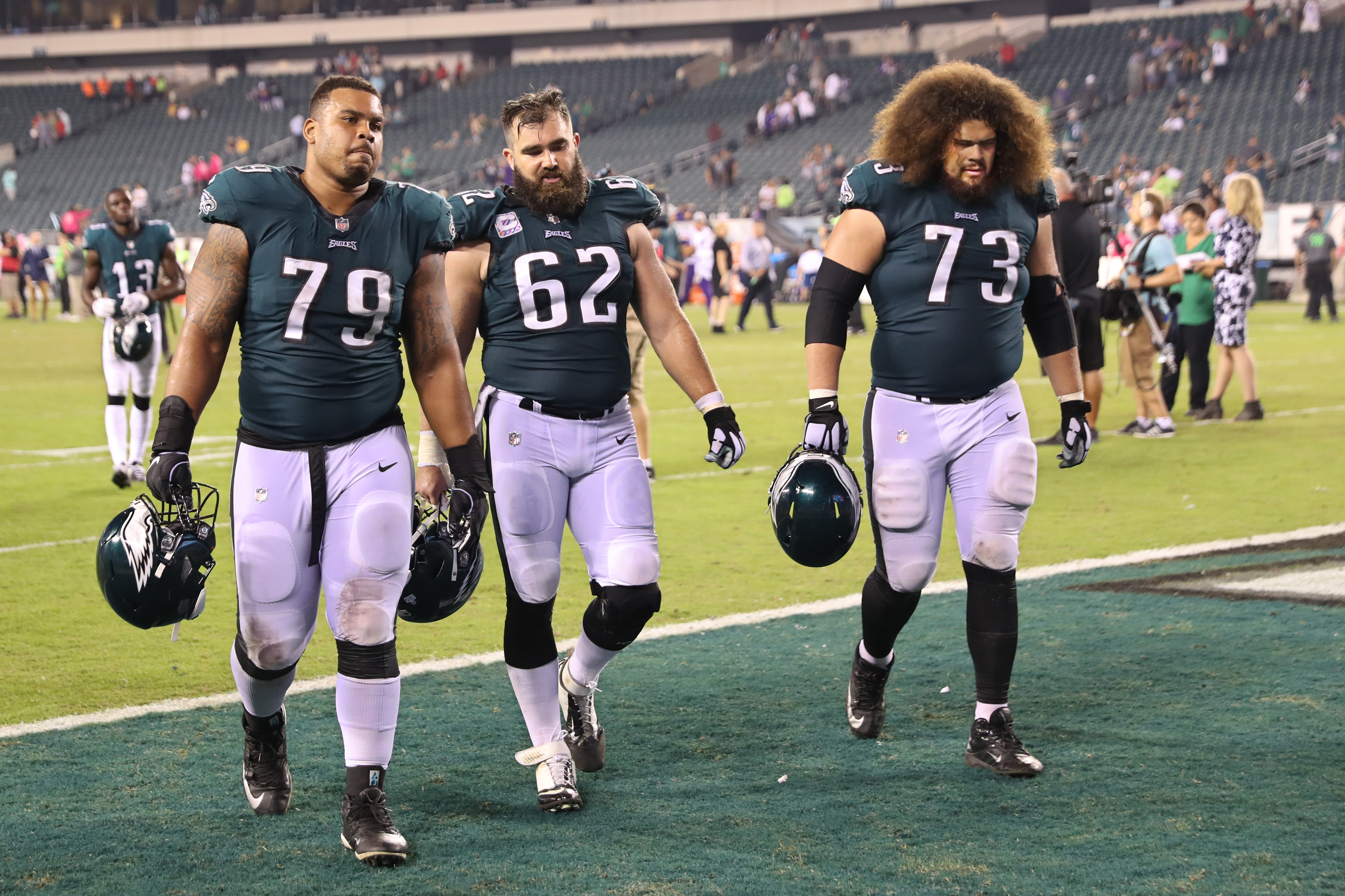 Brandon Brooks (left), Jason Kelce and Isaac Seumalo walk off the field after the Eagles lost to the Vikings on Sunday.