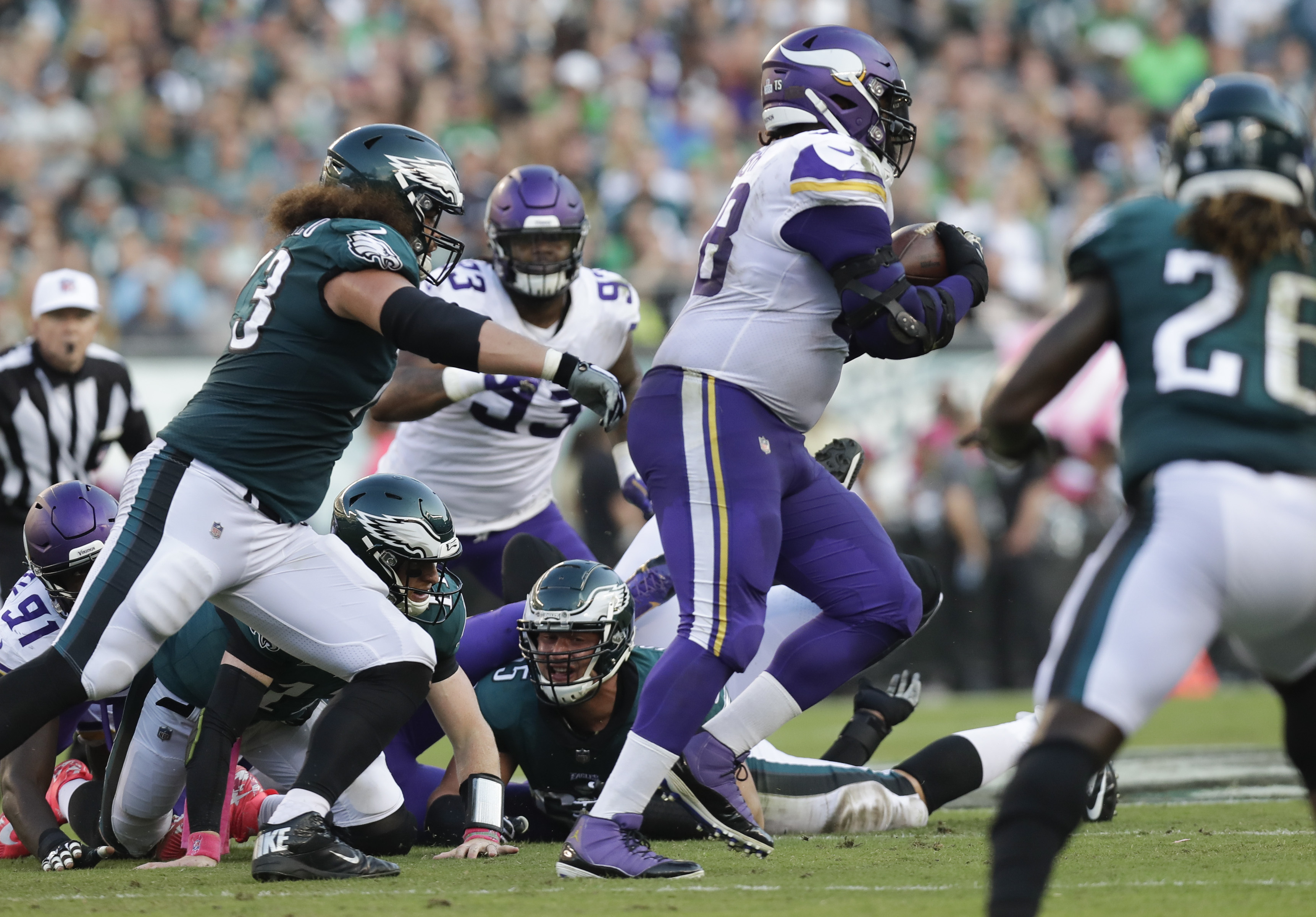 The Vikings' Linval Joseph runs past the Eagles' Isaac Seumalo en route to a touchdown after recovering a Carson Wentz fumble.