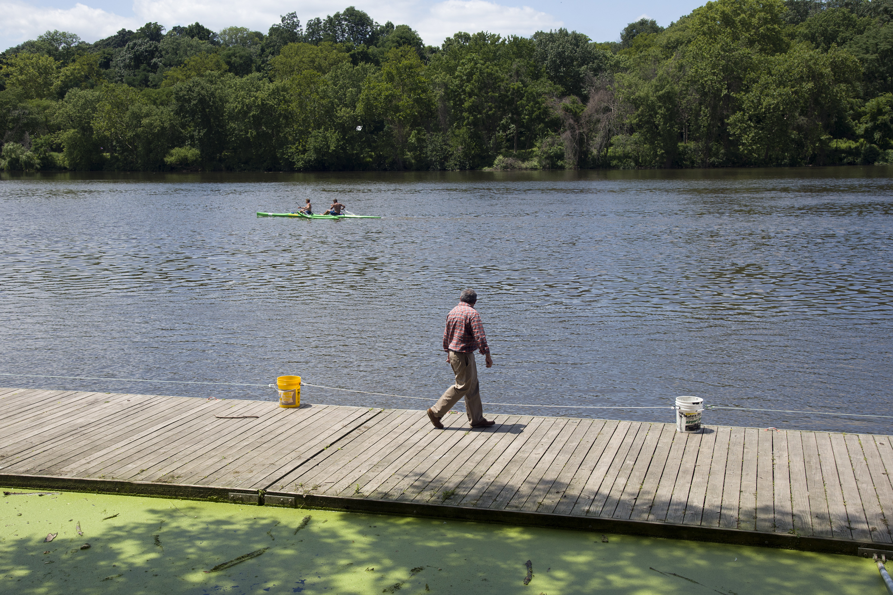 A visitor walks on the public dock on the Schuylkill River, where a toddler fell into the water on Saturday. TOM GRALISH / Staff Photographer