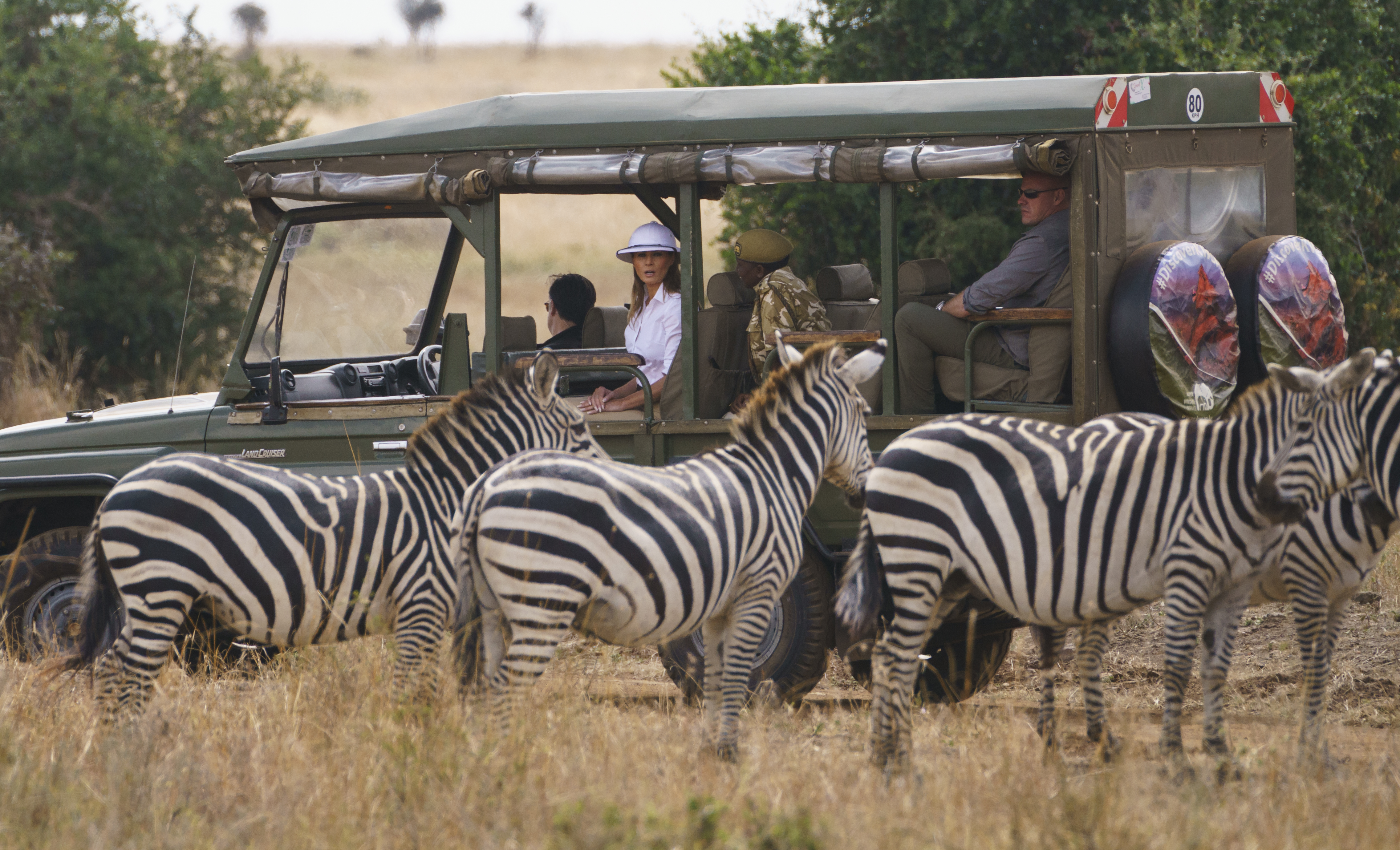 First lady Melania Trump observes zebras during a safari at Nairobi National Park in Nairobi, Kenya, Friday, Oct. 5, 2018. First lady Melania Trump is visiting Africa on her first big solo international trip, aiming to make child well-being the focus of a five-day, four-country tour. (AP Photo/Carolyn Kaster)