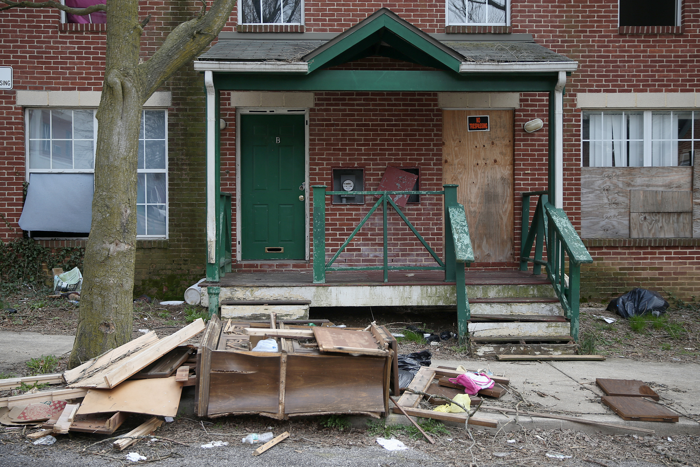 Built in the 1990s by Germantown Settlement, this housing complex at Collom and Lena streets in Germantown is boarderd up because of neglect.