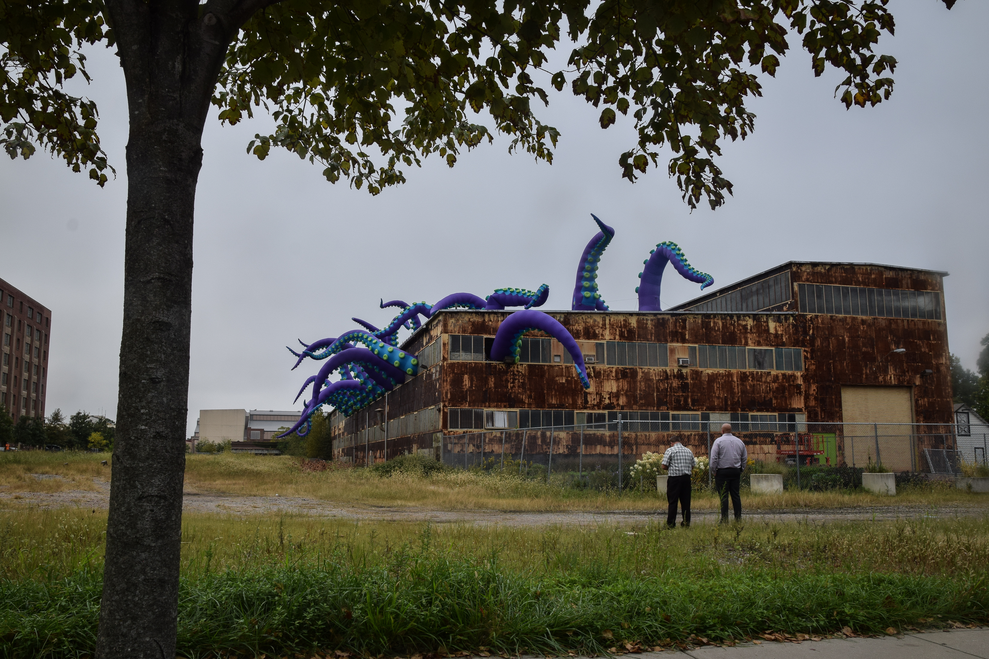 Onlookers gather Monday to look at the Navy Yard�s new art installation.