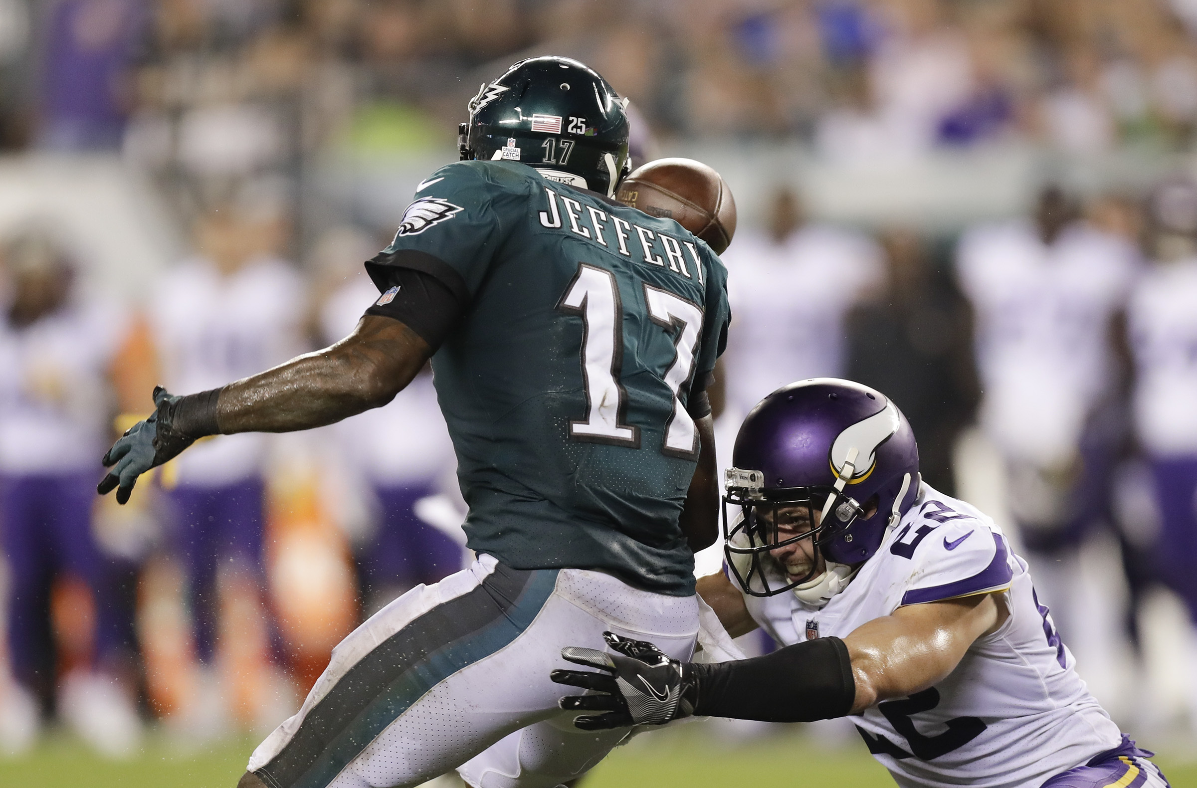 Eagles wide receiver Alshon Jeffery tries to catch the football against Minnesota Vikings free safety Harrison Smith during the fourth-quarter on Sunday, October 7, 2018 in Philadelphia.