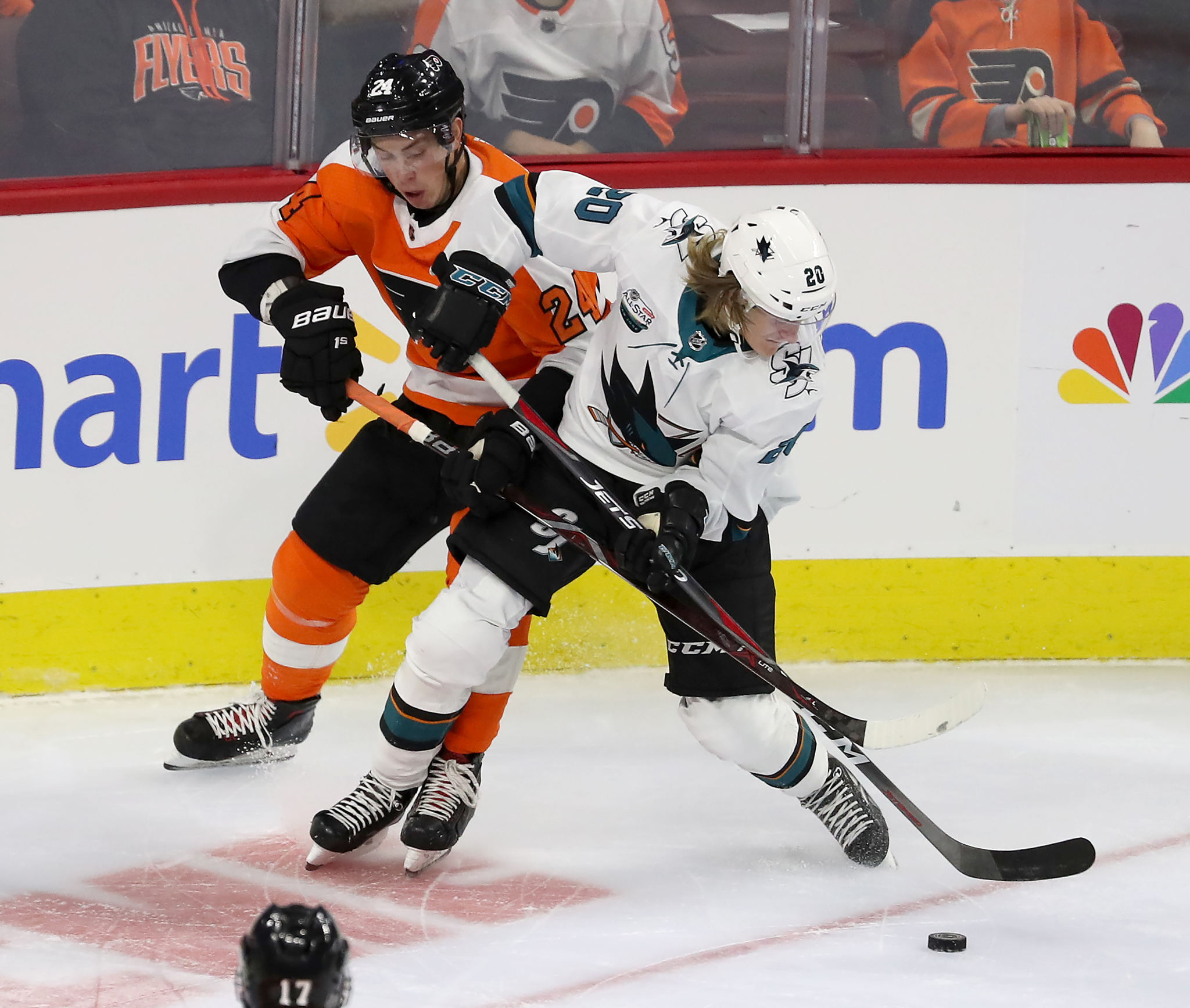Mikhail Vorobyev, left, of the Flyers and Marcus Sorensen of the Sharks battle for the puck  in the 1st period. The Flyers take the ice in their home opener against the Sharks on Oct. 9, 2018.