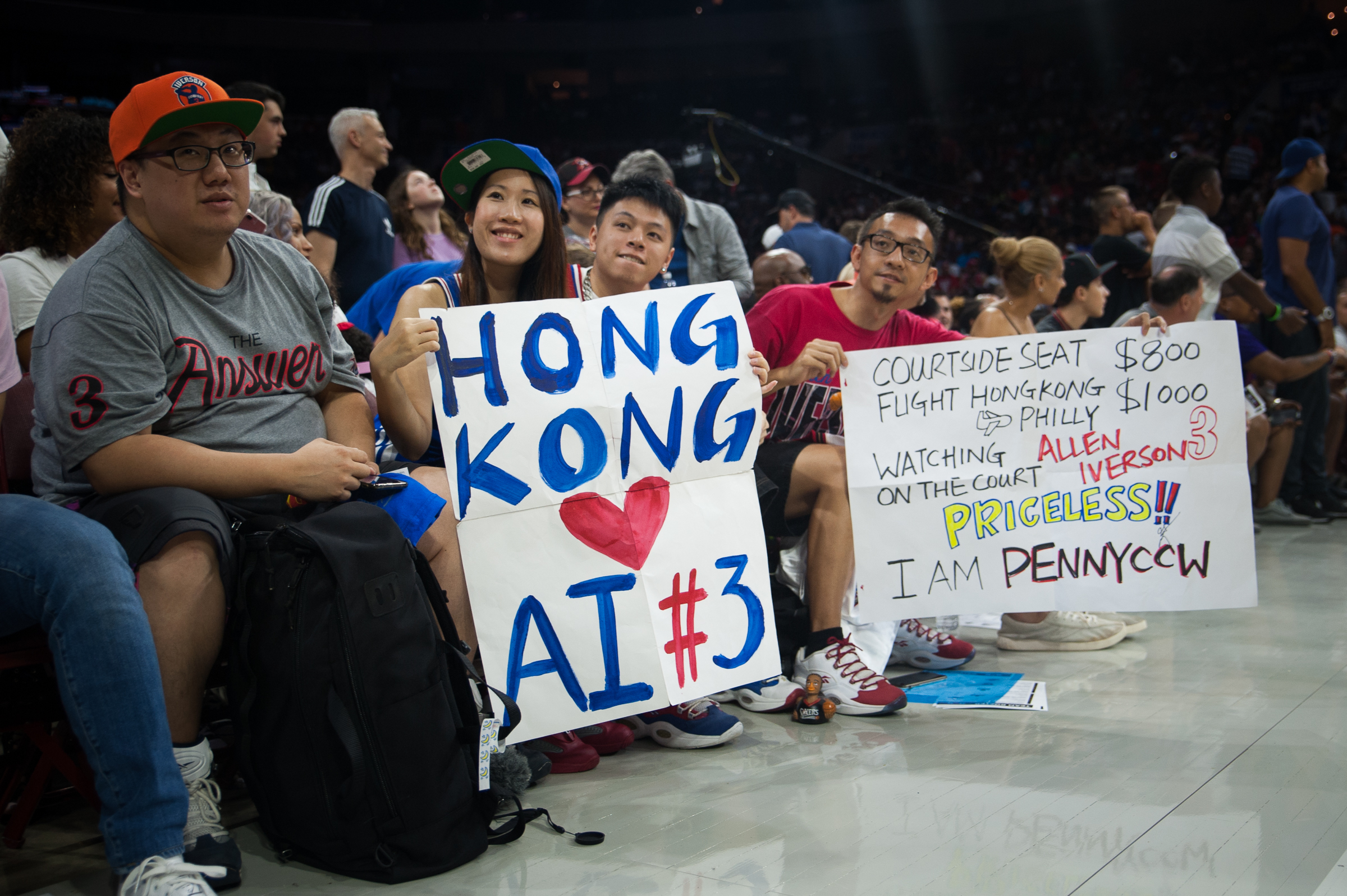 Ida Tsui and Adrian Wong, with their friend Penny Chan, arrived from Hong Kong to see Allen Iverson courtside, at Week Four of the Big 3 Tournament at the Wells Fargo Center, July 16th, 2017. CAMERON B. POLLACK / Staff Photographer